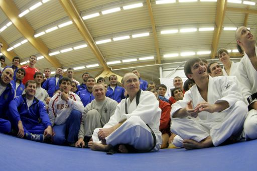 "Russia's Prime Minister Vladimir Putin (C) sits with a group at the ""Moscow"" sports complex in St Petersburg, on December 22, 2010 where he took part in a judo training session.   AFP PHOTO/ RIA-NOVOSTI POOL/ ALEXEY DRUZHININ"
