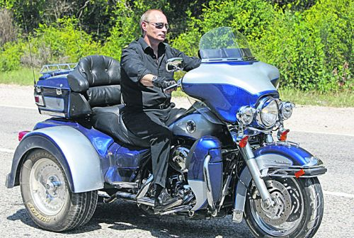 ????? ???? ???? ?????? Russian Prime Minister Vladimir Putin rides Harley Davidson Lehman Trike as he leaves the meeting with motorbikers at their camp at Gasfort Lake near Sevastopol in Ukraine's Crimea Peninsula on July 24, 2010. Putin  roared into a international biker convention in southern Ukraine. Around 5,000 bikers from Europe and beyond are gathered in Sevastopol for the annual festival on Ukraine's Crimea peninsula. AFP PHOTO / POOL / ALEXANDER ZEMLIANICHENKO