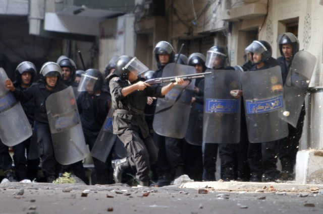 Egyptian Christians face riot police during confrontations on January 1, 2011 outside the Al-Qiddissine (The Saints) church following an overnight car bomb attack on the church in the Mediterranean port city of Alexandria in which 21 people people were killed, hitting Egypt's Christian community, the biggest in the Middle East. There was no immediate claim for the attack but Al-Qaeda has called for punishment of Egypt's Copts over claims that two priests' wives they say had converted to Islam were being held by the Church against their will. AFP PHOTO/MOHAMMED ABED , Angry Egyptian Christian mourners shout slogans on January 1, 2011 during the funeral of the victims of last night's bomb attack on a church in Alexandria at the Mar Mina (Saint Mina) monastery, 30 kms west of the Mediterranean port city. The overnight car bomb attack on Alexandria's Qiddissine (The Saints) church kille 21 people and wounded 79 others from Egypt's Christian community, the biggest in the Middle East. AFP PHOTO/MOHAMMED ABED , Egyptian Coptic Christian mourners carry the coffin of one of the victims of last night's bomb attack on a church in Alexandria during a funeral service on January 1, 2011 at the Mar Mina (Saint Mina) monastery, 30 kms west of the Mediterranean port city, which was the scene of an overnight car bomb attack killing 21 people and wounding 79 others from Egypt's Christian community, the biggest in the Middle East. AFP PHOTO/MOHAMMED ABED , Egyptian riot police clash with stone-throwing Christian youths on January 1, 2011 outside the Al-Qiddissine (The Saints) church following an overnight car bomb attack on the church in the Mediterranean port city of Alexandria in which 21 people people were killed, hitting Egypt's Christian community, the biggest in the Middle East. AFP PHOTO/MOHAMMED ABED