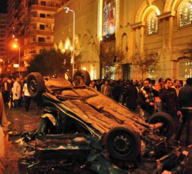 Egyptian Christians face riot police during confrontations on January 1, 2011 outside the Al-Qiddissine (The Saints) church following an overnight car bomb attack on the church in the Mediterranean port city of Alexandria in which 21 people people were killed, hitting Egypt's Christian community, the biggest in the Middle East. There was no immediate claim for the attack but Al-Qaeda has called for punishment of Egypt's Copts over claims that two priests' wives they say had converted to Islam were being held by the Church against their will. AFP PHOTO/MOHAMMED ABED , Angry Egyptian Christian mourners shout slogans on January 1, 2011 during the funeral of the victims of last night's bomb attack on a church in Alexandria at the Mar Mina (Saint Mina) monastery, 30 kms west of the Mediterranean port city. The overnight car bomb attack on Alexandria's Qiddissine (The Saints) church kille 21 people and wounded 79 others from Egypt's Christian community, the biggest in the Middle East. AFP PHOTO/MOHAMMED ABED , Egyptian Coptic Christian mourners carry the coffin of one of the victims of last night's bomb attack on a church in Alexandria during a funeral service on January 1, 2011 at the Mar Mina (Saint Mina) monastery, 30 kms west of the Mediterranean port city, which was the scene of an overnight car bomb attack killing 21 people and wounding 79 others from Egypt's Christian community, the biggest in the Middle East. AFP PHOTO/MOHAMMED ABED , Egyptian riot police clash with stone-throwing Christian youths on January 1, 2011 outside the Al-Qiddissine (The Saints) church following an overnight car bomb attack on the church in the Mediterranean port city of Alexandria in which 21 people people were killed, hitting Egypt's Christian community, the biggest in the Middle East. AFP PHOTO/MOHAMMED ABED , TOPSHOTS Egyptian Christians carry comrades in a position representing the crucifixion of Jesus Christ during a protest on January 2, 2011 outside the Al-Qiddissine (The Saints) church in Alexandria, following a New Year's Eve car bomb attack on the Coptic church in the northern Egyptian city in which 21 people were killed.    TOPSHOTS / AFP PHOTO / MOHAMMED ABED , Egyptian Christian coptics protest outside the al-Abasseya Cathedral in Cairo as Egyptian Grand Imam of Al-Azhar Ahmed al-Tayeb, Egyptian Mufti Ali Gomaa and Egypt?s Minister of Awqaf (religious endowments) Mahmud Hamdi Zaqzuq were leaving the cathedral after holding a joint press conference with Pope Shenouda III of Alexandria on January 2, 2011 following the New Year's Eve car bomb attack on a church in Alexandria in which 21 people, mostly coptic worshippers, were killed. AFP PHOTO/KHALED DESOUKI , TOPSHOTS Egyptian Coptic Christian mourners carry the coffin of one of the victims of last night's bomb attack on a church in Alexandria during a funeral service on January 1, 2011 at the Mar Mina (Saint Mina) monastery, 30 kms west of the Mediterranean port city, which was the scene of an overnight car bomb attack killing 21 people and wounding 79 others from Egypt's Christian community, the biggest in the Middle East.    TOPSHOTS / AFP PHOTO / MOHAMMED ABED , The body of an Egyptian Coptic man is seen on the ground following a car bomb attack outside the Al-Qiddissine (The Saints) church in the Egyptian port city of Alexandria on January 1, 2011 that killed 21 people, hitting Egypt's Christian community, the biggest in the Middle East. AFP PHOTO/STR , Egyptian policemen in plain clothes detain a Christian youth throwing stones at riot policemen during clashes on January 1, 2011 outside the Al-Qiddissine (The Saints) church following an overnight car bomb attack on the church in the Mediterranean port city of Alexandria in which 21 people people were killed, hitting Egypt's Christian community, the biggest in the Middle East. AFP PHOTO/MOHAMMED ABED TOPSHOTS , Egyptians inspect the site of a car bomb following an attack on a Christian church in the Egyptian port city of Alexandria on January 1, 2011.  At least seven people died and 24 were injured in a car bomb attack on a Christian church in the northern city of Alexandria, the Egyptian interior ministry said.   TOPSHOTS    AFP PHOTO