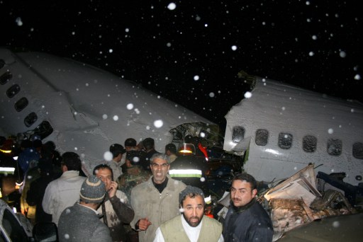 "RESTRICTED TO EDITORIAL USE - MANDATORY CREDIT ""AFP PHOTO / IRNA / ALIASQAR OFTADEH"" - NO MARKETING NO ADVERTISING CAMPAIGNS - DISTRIBUTED AS A SERVICE TO CLIENTS A handout photo provided by the Iranian news agency IRNA shows rescuers working near the wreckage of a state-run Iran Air Boeing 727 airliner late on January 9, 2011 near the northwestern city of Orumiyeh in the West Azerbaijan province. Iranian media reported on January 9 that the Iran Air plane crashed in bad weather and broke into pieces, killing at least 72 of the 105 people on board and injuring another 33.                AFP PHOTO/ IRNA/ ALIASQAR OFTADEH"