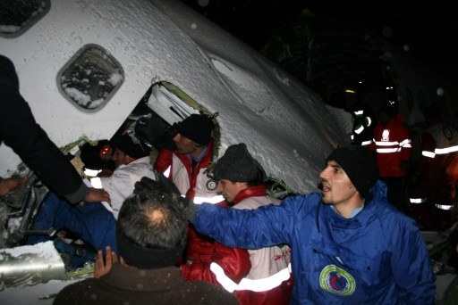 "RESTRICTED TO EDITORIAL USE - MANDATORY CREDIT ""AFP PHOTO / IRNA / ALIASQAR OFTADEH"" - NO MARKETING NO ADVERTISING CAMPAIGNS - DISTRIBUTED AS A SERVICE TO CLIENTS A handout photo provided by the Iranian news agency IRNA shows firefighters and Red Crescent rescuers working near the wreckage of a state-run Iran Air Boeing 727 airliner late on January 9, 2011 near the northwestern city of Orumiyeh in the West Azerbaijan province. Iranian media reported on January 9 that the Iran Air plane crashed in bad weather and broke into pieces, killing at least 72 of the 105 people on board and injuring another 33.                AFP PHOTO/ IRNA/ ALIASQAR OFTADEH"