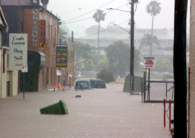 This image taken on January 10, 2011 shows flood waters swamping the shopping centre in the city of Toowoomba. Australia braced for a rapidly rising death toll on January 11 after flash floods killed eight and left 72 missing, as a quickly spreading flood disaster forced evacuations in central Brisbane.   TOPSHOTS  AFP PHOTO / Nicole Alayne HAMMERMEISTER