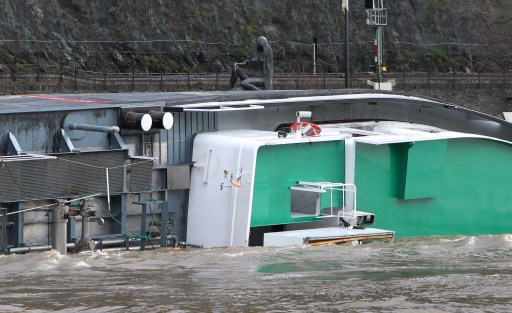 A ship loaded with 2400 tons of sulfuric acid has capsized on the Rhine river next to the Loreley statue near St. Goarshausen, western Germany, on January 13, 2011. Traffic on the river, a major European shipping artery, was suspended following the accident and two members of the crew were rescued but two others, one German one Czech, are missing according to a water police spokesman. The ship, the Waldhof, measures roughly 110 metres (360 feet) long and was completely turned over, with its keel above the waterline, but it was not immediately clear whether acid had leaked into the river    AFP PHOTO / DANIEL ROLAND