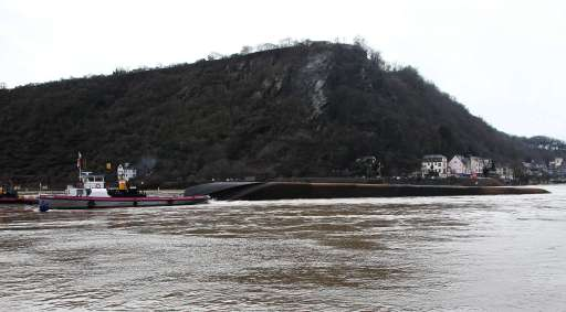 A ship loaded with 2400 tons of sulfuric acid has capsized on the Rhine river near St. Goarshausen, western Germany, on January 13, 2011. Traffic on the river, a major European shipping artery, was suspended following the accident and two members of the crew were rescued but two others, one German one Czech, are missing according to a water police spokesman. The ship, the Waldhof, measures roughly 110 metres (360 feet) long and was completely turned over, with its keel above the waterline, but it was not immediately clear whether acid had leaked into the river    AFP PHOTO / DANIEL ROLAND