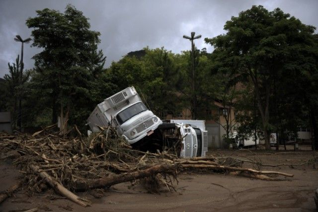 "Residents walks by a crater that engulfed a vehicle in a destroyed street in Nova Friburgo, Rio de Janeiro, Brazil, on January 16, 2011. The Brazilian military sent troops and helicopters Sunday to rescue stranded survivors of floods and landslides that killed more than 625 people but the operation was stymied by more bad weather. AFP PHOTO/Mauricio LIMA , A resident attempts to save some potatoes from floods in Nova Friburgo, Rio de Janeiro, Brazil, on January 16, 2011. The Brazilian military sent troops and helicopters Sunday to rescue stranded survivors of floods and landslides that killed more than 625 people but the operation was stymied by more bad weather. AFP PHOTO/Mauricio LIMA , A resident walks by a car engulfed by sand in Nova Friburgo, Rio de Janeiro, Brazil, on January 16, 2011. The Brazilian military sent troops and helicopters Sunday to rescue stranded survivors of floods and landslides that killed more than 625 people but the operation was stymied by more bad weather. AFP PHOTO/Mauricio LIMA , An eldelry lady leans out of her window in Nova Friburgo, Rio de Janeiro, Brazil, on January 16, 2011. The Brazilian military took advantage of a break in the weather Sunday to send helicopters to remote areas near Rio hit by landslides and flooding that killed at least 610 people. AFP PHOTO/Mauricio LIMA , A destroyed car stands amidst the remains of a destroyed house at Corrego Dantas neighbourhood, in Nova Friburgo, Rio de Janeiro, Brazil, on January 16, 2011. The Brazilian military sent troops and helicopters Sunday to rescue stranded survivors of floods and landslides that killed more than 625 people but the operation was stymied by more bad weather. AFP PHOTO/Mauricio LIMA , Relatives carry the coffin of a victim of a landslide at a cemetery in central Nova Friburgo, Rio de Janeiro, Brazil, on January 17, 2011.   The death toll from devastating floods and landslides in Brazil rose Monday to 640, as the military stepped up efforts to reach isolated communities near Rio. AFP PHOTO/Mauricio LIMA , A resident attempts to retrieve dog food from a heap on a street severely damaged by the recent floods in Nova Friburgo, Rio de Janeiro, Brazil, on January 17, 2011. The death toll from devastating floods and landslides in Brazil rose Monday to 640, as the military stepped up efforts to reach isolated communities near Rio. AFP PHOTO/Mauricio LIMA , A local resident attempts to retrieve animal food from a heap on a street severely damaged by the recent floods in Nova Friburgo, Rio de Janeiro, Brazil, on January 17, 2011. The death toll from devastating floods and landslides in Brazil rose Monday to 640, as the military stepped up efforts to reach isolated communities near Rio. AFP PHOTO/Mauricio LIMA , Brazilian Army soldiers find a corpse in Prainha, Nova Friburgo, 130 Km north of Rio de Janeiro, Brazil on January 17, 2011, after a landslide. Some 35 people died in this site in a landslide four days ago. The death toll from devastating floods and landslides in Brazil rose Monday to 640, as the military stepped up efforts to reach isolated communities near Rio.   AFP  PHOTO / ANTONIO SCORZA , Granale De Rosa check her belogings in the inside of their flooded house in Vieira, Teresopolis, 130 Km north of Rio de Janeiro, Brazil on January 17, 2011. The death toll from devastating floods and landslides in Brazil rose Monday to 640, as the military stepped up efforts to reach isolated communities near Rio.  AFP PHOTO / ANTONIO SCORZA , Jose Americo looks at the wreckage of his car outside his house during floods in Vieira, Teresopolis, 130 Km north Rio de Janeiro, Brazil on January 17, 2011. The death toll from devastating floods and landslides in Brazil rose Monday to 640, as the military stepped up efforts to reach isolated communities near Rio.  AFP PHOTO / ANTONIO SCORZA , Brazilian Army soldiers carry a corpse in a plastic bag at Campo do Coelho rescued from a house destroyed by a landslide in Nova Friburgo outskirts, 130 Km north of Rio de Janeiro, Brazil on January 17, 2011. The death toll from devastating floods and landslides in Brazil rose Monday to 640, as the military stepped up efforts to reach isolated communities near Rio.   AFP  PHOTO / ANTONIO SCORZA , Brazilian Army soldiers carry a corpse in a plastic bag at Campo do Coelho rescued from a house destroyed by a landslide in Nova Friburgo outskirts, 130 Km north of Rio de Janeiro, Brazil on January 17, 2011. The death toll from devastating floods and landslides in Brazil rose Monday to 640, as the military stepped up efforts to reach isolated communities near Rio.   AFP  PHOTO / ANTONIO SCORZA , Brazilian Air Force members help a woman who was rescued with her children at a temporary air base in Itaipava, Petropolis, some 100 km from downtown Rio de Janeiro, Brazil, on January 17, 2011. The death toll from devastating floods and landslides in Brazil rose Monday to 640, as the military stepped up efforts to reach isolated communities near Rio.  AFP PHOTO/VANDERLEI ALMEIDA , A man washes a mannequin at a textile shop which products were destroyed by the recent floods at California neighbourhood, in Nova Friburgo, Rio de Janeiro, Brazil, on January 17, 2011. The death toll from devastating floods and landslides in Brazil rose to 640, as the military stepped up efforts to reach isolated communities near Rio.      TOPSHOTS        AFP PHOTO/Mauricio LIMA , Tunisian demostrators hold up shells and empty tear-gas cannisters, reportedly used by security forces against demonstrators during clashes on January 10, 2011 in Regueb, near Sidi Bouzid. Fresh clashes broke out in Tunisia today as the EU condemned a government crackdown on weekend protests over food and jobs that killed at least 14 people. AFP PHOTO/STR , A Tunisian demostrator gestures and holds a rock in his other hand during clashes between security forces and demonstrators on January 10, 2011 in Regueb, near Sidi Bouzid. Fresh clashes broke out in Tunisia today as the EU condemned a government crackdown on weekend protests over food and jobs that killed at least 14 people. AFP PHOTO/STR , Tunisian security forces face demonstrators during clashes on January 10, 2011 in Regueb, near Sidi Bouzid. Fresh clashes broke out in Tunisia today as the EU condemned a government crackdown on weekend protests over food and jobs that killed at least 14 people. AFP PHOTO/STR , A Tunisian demostrator prepares to throw a tear-gas cannister during clashes with security forces on January 10, 2011 in Regueb, near Sidi Bouzid. Fresh clashes broke out in Tunisia today as the EU condemned a government crackdown on weekend protests over food and jobs that killed at least 14 people. AFP PHOTO/STR , A Tunisian demonstrator prepares to run during clashes with security forces in Regueb, near Sidi Bouzid on January 10, 2011.  At least 35 people have been killed in rioting that erupted over the weekend in Tunisia, International Federation for Human Rights president Souhayr Belhassen told AFP. AFP PHOTO/STR , People hold a banner reading ""Tunisia, stop massacre"" during a demonstration against Tunisian President Zine El Abidine Ben Ali on January 11, 2011 in Paris. Anger over a government crackdown on protesters in Tunisia grew Tuesday as a union official said 50 were killed in three days of violence, more than double a toll issued by the interior ministry. AFP PHOTO LIONEL BONAVENTURE , Tunisian military stand guard in Tunis center on January 13, 2011. Police and anti-riot forces deployed into the city centre in strength as tensions mounted after another attempt to march earlier in the day.  The violence flared in Tunisia after weeks of protests that initially focused on high unemployment, sparked by the suicide of a young graduate who set himself alight on December 17. AFP PHOTO / FETHI BELAID , Tunisian soldiers clash with demonstrators during a protest on Mohamed V avenue on January 14, 2011 in Tunis. Tunisian President Zine El Abidine Ben Ali  has left Tunisia, say sources close to government on January 14, 2011 after he called a state of emergency and fired his government  as escalating protests over his rule forced the evacuation of thousands of European tourists.AFP PHOTO / FETHI BELAID , Demonstrators take part in a rally to pay tribute to the 'blood of the martyrs' and celebrate the departure of embattled Tunisia's President Zine El Abidine Ben Ali outside the International Court in The Hague on January 14, 2011.   Tunisian President Zine el Abidine Ben Ali, who has ruled the country since 1987, quit on January 14, 2010 and left the country after deadly protests, becoming the latest leader to flee under popular pressure. Prime Minister Mohammed Ghannouchi announced on state television that he had taken over as interim president, after a day of violent clashes between rock-throwing protesters and riot police in the streets of central Tunis. AFP PHOTO  ANP ROBERT VOS netherlands out - belgium out , Smoke billows from a French and a Tunisian supermarket on January 15, 2011 in La Gazella city near Tunis. Tunisia's speaker of parliament took power on todya amid chaotic scenes in the streets of the capital after President Zine El Abidine Ben Ali fled from protests after 23 years of iron-fisted rule. The army locked down central Tunis to prevent further demos and AFP reporters saw soldiers and plainclothes security personnel dragging dozens of suspected looters out of their cars at gunpoint and taking them away in trucks. AFP PHOTO / FETHI BELAID , Smoke billows from a French and a Tunisian supermarket on January 15, 2011 in La Gazella city near Tunis. Tunisia's speaker of parliament took power on todya amid chaotic scenes in the streets of the capital after President Zine El Abidine Ben Ali fled from protests after 23 years of iron-fisted rule. The army locked down central Tunis to prevent further demos and AFP reporters saw soldiers and plainclothes security personnel dragging dozens of suspected looters out of their cars at gunpoint and taking them away in trucks. AFP PHOTO / FETHI BELAID , People take cloth from a looted store near a supermarket on January 15, 2011 in La Gazella city near Tunis. Tunisia's speaker of parliament took power on today amid chaotic scenes in the streets of the capital after President Zine El Abidine Ben Ali fled from protests after 23 years of iron-fisted rule. The army locked down central Tunis to prevent further demos and AFP reporters saw soldiers and plainclothes security personnel dragging dozens of suspected looters out of their cars at gunpoint and taking them away in trucks. AFP PHOTO / FETHI BELAID , A woman holds a banner reading ""Bravo Tunisia, tomorow Ivory Coast"" during a rally gathering supporters of internationally recognised Ivory Coast president Alassane Ouattara in front of the EU Headquarters in Brussels on January 15, 2011, a day after the EU decided to freeze the European assets of Ivory Coast's outcast leader Laurent Gbagbo, 84 associates and 11 vital industries over his refusal to cede power. The sanctions against industries in the world's top cocoa-producer target the board that manages the country's coffee and cocoa business (CGFCC), the national oil company Petroci and the port of Abidjan.  AFP PHOTO / GEORGES GOBET"