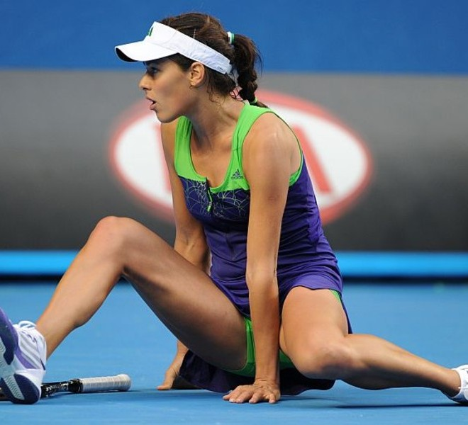 Ana Ivanovic of Serbia sits on the floor after slipping during her round one women's singles match against Ekaterina Makarova of Russia on the second day of the Australian Open tennis tournament in Melbourne on January 18, 2011. Former world number one Ivanovic made a shock early exit from the Australian Open on January 18, beaten in the first round by 49th-ranked Russian Makarova 3-6, 6-4, 10-8.  IMAGE STRICTLY RESTRICTED TO EDITORIAL USE ? STRICTLY NO COMMERCIAL USE   AFP PHOTO / NICOLAS ASFOURI