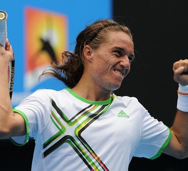 Alexandr Dolgopolov of Ukraine celebrates beating Robin Soderling of Sweden during their round four men's singles match on the eighth day of the Australian Open tennis tournament in Melbourne on January 24, 2011.  Dolgopolov won 1-6, 6-3, 6-1, 4-6, 6-2.  IMAGE STRICTLY RESTRICTED TO EDITORIAL USE ? STRICTLY NO COMMERCIAL USE   AFP PHOTO / TORSTEN BLACKWOOD