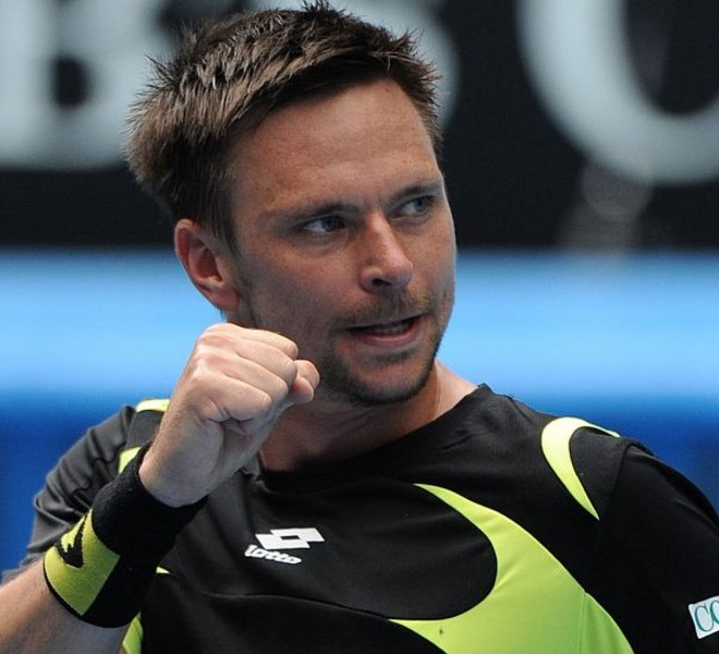 Robin Soderling of Sweden pumps his fist after winning a point against Alexandr Dolgopolov of Ukraine during their round four men's singles match on the eighth day of the Australian Open tennis tournament in Melbourne on January 24, 2011.  The match was tied at one set all as play continued in the third.  IMAGE STRICTLY RESTRICTED TO EDITORIAL USE ? STRICTLY NO COMMERCIAL USE   AFP PHOTO / GREG WOOD