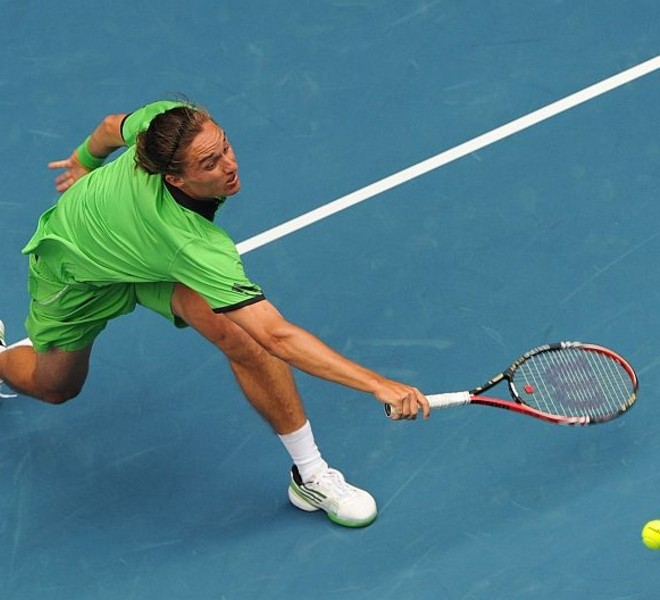 Alexandr Dolgopolov of Ukraine plays a stroke during his fourth round men's singles match against Robin Soderling of Sweden on the eighth day of the Australian Open tennis tournament in Melbourne on January 24, 2011.     The match is tied at two sets all as play continues.          IMAGE STRICTLY RESTRICTED TO EDITORIAL USE    ?    STRICTLY NO COMMERCIAL USE      AFP PHOTO/William WEST