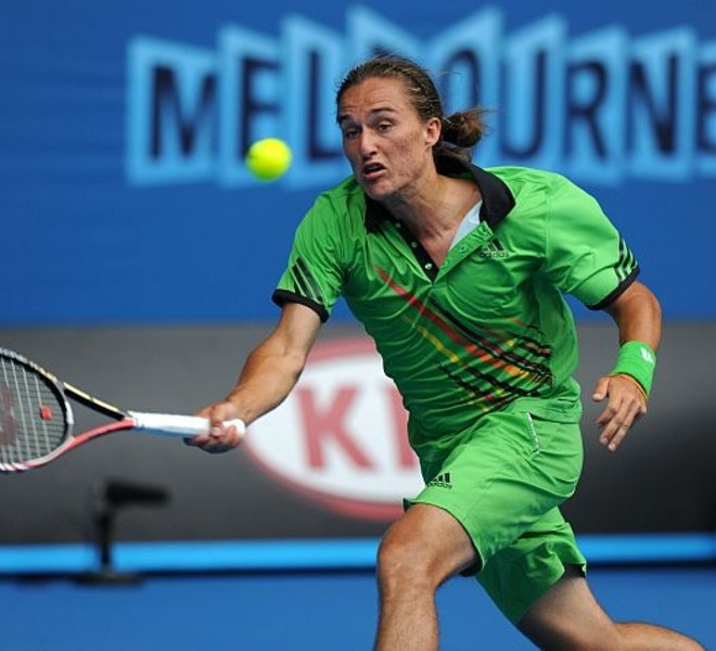 Alexandr Dolgopolov of Ukraine returns against Robin Soderling of Sweden during their round four men's singles match on the eighth day of the Australian Open tennis tournament in Melbourne on January 24, 2011.  The match was tied at one set all as play continued in the third.  IMAGE STRICTLY RESTRICTED TO EDITORIAL USE ? STRICTLY NO COMMERCIAL USE   AFP PHOTO / GREG WOOD