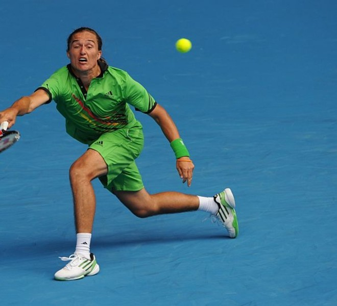 Alexandr Dolgopolov of Ukraine returns against Robin Soderling of Sweden during their round four men's singles match on the eighth day of the Australian Open tennis tournament in Melbourne on January 24, 2011.  Dolgopolov won 1-6, 6-3, 6-1, 4-6, 6-2.  IMAGE STRICTLY RESTRICTED TO EDITORIAL USE ? STRICTLY NO COMMERCIAL USE   AFP PHOTO / WILLIAM WEST