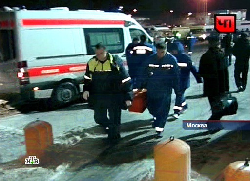 "RESTRICTED TO EDITORIAL USE - MANDATORY CREDIT ""AFP PHOTO / NTV"" - NO MARKETING NO ADVERTISING CAMPAIGNS - DISTRIBUTED AS A SERVICE TO CLIENTS A TV grab taken from Russian TV channel NTV shows paramedics rushing toward the blast sit at Moscow's Domodedovo international airport on January 24, 2011, shortly after an explosion. A suspected suicide bombing on January 24 killed at least 31 people and wounded over 100 at the airport in an attack described by investigators as an act of terror. Eyewitnesses, who spoke to Russian radio, described a scene of carnage after the blast ripped through the baggage claims section of the arrivals hall at Russia's largest airport. AFP PHOTO/NTV"