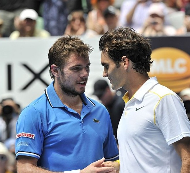 Roger Federer of Switzerland (R) and Stanislas Wawrinka of Switzerland (L) shake hands at the net after Federer won their quarter-final men's singles match on the ninth day of the Australian Open tennis tournament in Melbourne on January 25, 2011.  Federer won 6-1, 6-3, 6-3.  IMAGE STRICTLY RESTRICTED TO EDITORIAL USE ? STRICTLY NO COMMERCIAL USE   AFP PHOTO / PAUL CROCK
