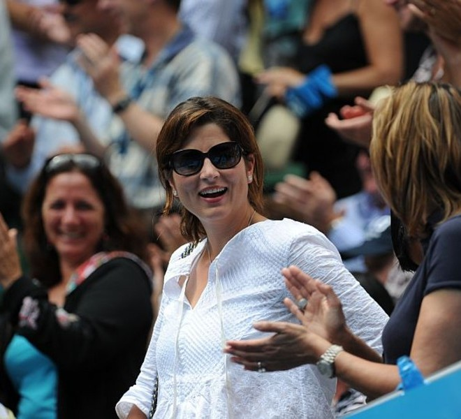 Roger Federer of Switzerland's wife Mirka smiles in the crowd after her husband beat Stanislas Wawrinka of Switzerland at the end of their quarter-final men's singles match on the ninth day of the Australian Open tennis tournament in Melbourne on January 25, 2011.  Federer won 6-1, 6-3, 6-3.  IMAGE STRICTLY RESTRICTED TO EDITORIAL USE ? STRICTLY NO COMMERCIAL USE   AFP PHOTO / WILLIAM WEST