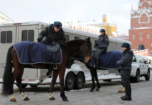 "Mounted police officers prepare to patrol the area around the Moscow Kremlin, on January 25, 2011, the  day after the Moscow airport bomb blast that killed 35 people. President Dmitry Medvedev on Tuesday called terror the most serious threat to Russia and vowed to ""liquidate"" the militants behind the Moscow airport bomb blast that killed 35 people.AFP PHOTO / ANDREY SMIRNOV"