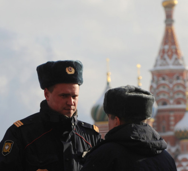 Police officers patrol the Red Square in Moscow, on January 25, 2011, the next day after the Moscow airport bomb blast that killed 35 people. Russian investigators have linked the attack -- the second to strike Moscow in less than a year -- to a suicide bomber from the country's predominantly Muslim North Caucasus region. AFP PHOTO / ANDREY SMIRNOV