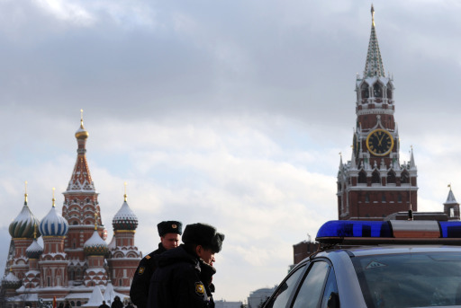 Police officers patrol the Red Square in Moscow, on January 25, 2011, the day after the Moscow airport bomb blast that killed 35 people. Russian investigators have linked the attack -- the second to strike Moscow in less than a year -- to a suicide bomber from the country's predominantly Muslim North Caucasus region. AFP PHOTO / ANDREY SMIRNOV