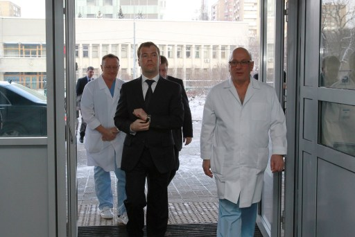 "Russian President Dmitry Medvedev (C) listens to head of Sklifosovsky Emergency Care Research Institute Anzor Khubutiya (R) during his visit to 11 victims of the January 24 blast at Domodedovo airport in Moscow on January 25, 2011 at Sklifovsky hopistal in Moscow. Dmitry Medvedev on Tuesday vowed to hunt down Islamist militants and lashed out at ""anarchic"" security lapses after a suicide bomber slaughtered 35 people in arrivals at Russia's main airport. AFP PHOTO / RIA NOVOSTI"