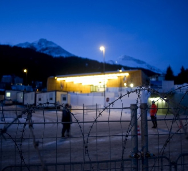 "Picture taken on January 24, 2011 shows the Congress Center where the World Economic Forum annual meeting will take place in Davos. Switzerland has mobilised up to 5,000 soldiers to secure the areas surrounding the alpine village of Davos, where world political and economic leaders are to gather this week. AFP PHOTO /JOHANNES EISELE , A sniper of Swiss police stands on top of the Congress Center on January 25, 2011 in Davos where the World Economic Forum annual meeting will take place . Switzerland has mobilised up to 5,000 soldiers to secure the areas surrounding the alpine village of Davos, where world political and economic leaders are to gather this week. AFP PHOTO /JOHANNES EISELE , Staff install a painting inside the Davos' Congress Center ahead of the World Economic Forum annual meeting on January 25, 2011 in Davos. The eurozone's debt battle and the power shift towards emerging giants like China and India will be at the heart of discussions on a ""fundamentally changed world"" at this week's Davos meeting of global elites.    AFP PHOTO / FABRICE COFFRINI , Empty seats are ready at the Davos' Congress Center ahead of the World Economic Forum annual meeting on January 25, 2011 in Davos. The eurozone's debt battle and the power shift towards emerging giants like China and India will be at the heart of discussions on a ""fundamentally changed world"" at this week's Davos meeting of global elites.    AFP PHOTO / FABRICE COFFRINI , A Swiss police sniper stands on the roof of the Congress Center on January 25, 2011 on the eve of the World Economic Forum annual meeting in Davos. Switzerland has mobilized up to 5,000 soldiers to secure the area surrounding the alpine village of Davos, where world political and economic leaders are to gather this week. AFP PHOTO / JOHANNES EISELE , A Swiss police sniper stands on the roof of the Congress Center on January 25, 2011 on the eve of the World Economic Forum annual meeting in Davos. Switzerland has mobilized up to 5,000 soldiers to secure the area surrounding the alpine village of Davos, where world political and economic leaders are to gather this week. AFP PHOTO / JOHANNES EISELE , A woman cleans stairs of the Congress Center on January 25, 2011 on the eve of the World Economic Forum annual meeting in Davos. Switzerland has mobilized up to 5,000 soldiers to secure the area surrounding the alpine village of Davos, where world political and economic leaders are to gather this week. AFP PHOTO / JOHANNES EISELE , A Swiss police sniper stands on the roof of the Belvedere Hotel on January 25, 2011 in Davos. Switzerland has mobilised up to 5,000 soldiers to secure the areas surrounding the alpine village of Davos, where world political and economic leaders are to gather this week.   AFP PHOTO /JOHANNES EISELE , A Swiss police sniper stands on a roof near the Davos Congress center ahead of the World Economic Forum annual meeting on January 25, 2011 in Davos. Switzerland has mobilised up to 5,000 soldiers to secure the areas surrounding the alpine village of Davos, where world political and economic leaders are to gather this week.     AFP PHOTO / FABRICE COFFRINI , Snipers take position on the roof of the Congress Center on January 25, 2011 on the eve of the World Economic Forum annual meeting in Davos. Switzerland has mobilized up to 5,000 soldiers to secure the area surrounding the alpine village of Davos, where world political and economic leaders are to gather this week. AFP PHOTO / FABRICE COFFRINI , A sniper stands on the roof of the Congress Center on January 25, 2011 on the eve of the World Economic Forum annual meeting in Davos. Switzerland has mobilized up to 5,000 soldiers to secure the area surrounding the alpine village of Davos, where world political and economic leaders are to gather this week. AFP PHOTO / FABRICE COFFRINI , Two Swiss police keep watch during the World Economic Forum annual meeting  on January 26, 2011 in Davos. Switzerland has mobilised up to 5,000 soldiers to secure the areas surrounding the alpine village of Davos, where world political and economic leaders are to gather this week. AFP PHOTO /JOHANNES EISELE , The village of Davos is seen prior to the opening of the World Economic Forum (WEF) on January 23, 2011. The Swiss resort of Davos hosts the WEF from January 26 to 30, 2011.  AFP PHOTO / FABRICE COFFRINI , A Swiss soldier watches close to fences ahead of the World Economic Forum annual meeting on January 24, 2011 in Davos. Switzerland has mobilised up to 5,000 soldiers to secure the areas surrounding the alpine village of Davos, where world political and economic leaders are to gather this week.  AFP PHOTO / FABRICE COFFRINI , Swisss soldiers install fences ahead of the World Economic Forum annual meeting on January 24, 2011 in Davos. Switzerland has mobilised up to 5,000 soldiers to secure the areas surrounding the alpine village of Davos, where world political and economic leaders are to gather this week. AFP PHOTO / JOHANNES EISELE , Swisss soldiers install fences ahead of the World Economic Forum annual meeting  on January 24, 2011 in Davos. Switzerland has mobilised up to 5,000 soldiers to secure the areas surrounding the alpine village of Davos, where world political and economic leaders are to gather this week. AFP PHOTO /JOHANNES EISELE , Workers work on the construction site of Olympiyski stadium in Kiev on January 24, 2011.Poland and Ukraine will co-host the 2012 European Soccer Championship. AFP PHOTO/ SERGEI SUPINSKY , A worker uses a ladder work in the main hall of the Congress Center where the World Economic Forum annual meeting will take place is pictured on January 24, 2011 in Davos. Switzerland has mobilised up to 5,000 soldiers to secure the areas surrounding the alpine village of Davos, where world political and economic leaders are to gather this week. AFP PHOTO /JOHANNES EISELE , A worker sets up a welcome desk at the Congress Center where the World Economic Forum annual meeting will take place on January 24, 2011 in Davos.  Switzerland has mobilised up to 5,000 soldiers to secure the areas surrounding the alpine village of Davos, where world political and economic leaders are to gather this week. AFP PHOTO /JOHANNES EISELE , A worker sets up light in a ""tunnel entrance"" outside the Congress Center where the World Economic Forum annual meeting will take place on January 24, 2011 in Davos. Switzerland has mobilised up to 5,000 soldiers to secure the areas surrounding the alpine village of Davos, where world political and economic leaders are to gather this week. AFP PHOTO /JOHANNES EISELE , A worker vacuums on January 24, 2011 the Davos Congress Center ahead of the January 26 opening of the World Economic Forum annual meeting in Davos. The eurozone's debt battle and the power shift toward emerging giants, like China and India, will be at the heart of discussions on a ""fundamentally changed world"" at this week's Davos meeting of global elites. AFP PHOTO /JOHANNES EISELE , The village of Davos is seen by night ahead of the World Economic Forum annual meeting on January 24, 2011 in Davos. The eurozone's debt battle and the power shift towards emerging giants like China and India will be at the heart of discussions on a ""fundamentally changed world"" at this week's Davos meeting of global elites.   AFP PHOTO / FABRICE COFFRINI , A Barbed wire fence is seen in front of the Congress Center where the World Economic Forum annual meeting will take place on January 24, 2011 in Davos. Switzerland has mobilised up to 5,000 soldiers to secure the areas surrounding the alpine village of Davos, where world political and economic leaders are to gather this week. AFP PHOTO /JOHANNES EISELE"