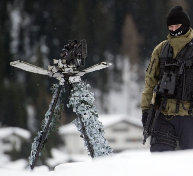 Picture taken on January 24, 2011 shows the Congress Center where the World Economic Forum annual meeting will take place in Davos. Switzerland has mobilised up to 5,000 soldiers to secure the areas surrounding the alpine village of Davos, where world political and economic leaders are to gather this week. AFP PHOTO /JOHANNES EISELE , A sniper of Swiss police stands on top of the Congress Center on January 25, 2011 in Davos where the World Economic Forum annual meeting will take place . Switzerland has mobilised up to 5,000 soldiers to secure the areas surrounding the alpine village of Davos, where world political and economic leaders are to gather this week. AFP PHOTO /JOHANNES EISELE
