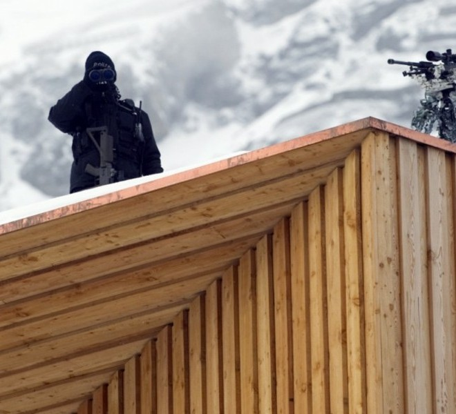 "Picture taken on January 24, 2011 shows the Congress Center where the World Economic Forum annual meeting will take place in Davos. Switzerland has mobilised up to 5,000 soldiers to secure the areas surrounding the alpine village of Davos, where world political and economic leaders are to gather this week. AFP PHOTO /JOHANNES EISELE , A sniper of Swiss police stands on top of the Congress Center on January 25, 2011 in Davos where the World Economic Forum annual meeting will take place . Switzerland has mobilised up to 5,000 soldiers to secure the areas surrounding the alpine village of Davos, where world political and economic leaders are to gather this week. AFP PHOTO /JOHANNES EISELE , Staff install a painting inside the Davos' Congress Center ahead of the World Economic Forum annual meeting on January 25, 2011 in Davos. The eurozone's debt battle and the power shift towards emerging giants like China and India will be at the heart of discussions on a ""fundamentally changed world"" at this week's Davos meeting of global elites.    AFP PHOTO / FABRICE COFFRINI , Empty seats are ready at the Davos' Congress Center ahead of the World Economic Forum annual meeting on January 25, 2011 in Davos. The eurozone's debt battle and the power shift towards emerging giants like China and India will be at the heart of discussions on a ""fundamentally changed world"" at this week's Davos meeting of global elites.    AFP PHOTO / FABRICE COFFRINI , A Swiss police sniper stands on the roof of the Congress Center on January 25, 2011 on the eve of the World Economic Forum annual meeting in Davos. Switzerland has mobilized up to 5,000 soldiers to secure the area surrounding the alpine village of Davos, where world political and economic leaders are to gather this week. AFP PHOTO / JOHANNES EISELE"