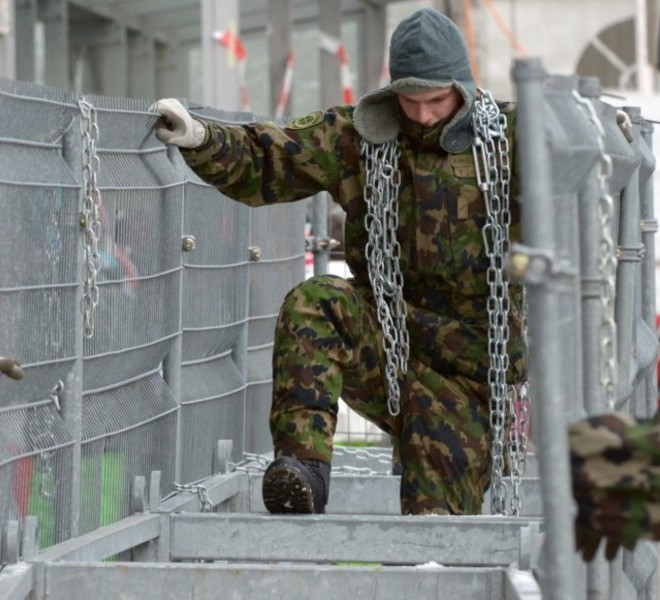 "Picture taken on January 24, 2011 shows the Congress Center where the World Economic Forum annual meeting will take place in Davos. Switzerland has mobilised up to 5,000 soldiers to secure the areas surrounding the alpine village of Davos, where world political and economic leaders are to gather this week. AFP PHOTO /JOHANNES EISELE , A sniper of Swiss police stands on top of the Congress Center on January 25, 2011 in Davos where the World Economic Forum annual meeting will take place . Switzerland has mobilised up to 5,000 soldiers to secure the areas surrounding the alpine village of Davos, where world political and economic leaders are to gather this week. AFP PHOTO /JOHANNES EISELE , Staff install a painting inside the Davos' Congress Center ahead of the World Economic Forum annual meeting on January 25, 2011 in Davos. The eurozone's debt battle and the power shift towards emerging giants like China and India will be at the heart of discussions on a ""fundamentally changed world"" at this week's Davos meeting of global elites.    AFP PHOTO / FABRICE COFFRINI , Empty seats are ready at the Davos' Congress Center ahead of the World Economic Forum annual meeting on January 25, 2011 in Davos. The eurozone's debt battle and the power shift towards emerging giants like China and India will be at the heart of discussions on a ""fundamentally changed world"" at this week's Davos meeting of global elites.    AFP PHOTO / FABRICE COFFRINI , A Swiss police sniper stands on the roof of the Congress Center on January 25, 2011 on the eve of the World Economic Forum annual meeting in Davos. Switzerland has mobilized up to 5,000 soldiers to secure the area surrounding the alpine village of Davos, where world political and economic leaders are to gather this week. AFP PHOTO / JOHANNES EISELE , A Swiss police sniper stands on the roof of the Congress Center on January 25, 2011 on the eve of the World Economic Forum annual meeting in Davos. Switzerland has mobilized up to 5,000 soldiers to secure the area surrounding the alpine village of Davos, where world political and economic leaders are to gather this week. AFP PHOTO / JOHANNES EISELE , A woman cleans stairs of the Congress Center on January 25, 2011 on the eve of the World Economic Forum annual meeting in Davos. Switzerland has mobilized up to 5,000 soldiers to secure the area surrounding the alpine village of Davos, where world political and economic leaders are to gather this week. AFP PHOTO / JOHANNES EISELE , A Swiss police sniper stands on the roof of the Belvedere Hotel on January 25, 2011 in Davos. Switzerland has mobilised up to 5,000 soldiers to secure the areas surrounding the alpine village of Davos, where world political and economic leaders are to gather this week.   AFP PHOTO /JOHANNES EISELE , A Swiss police sniper stands on a roof near the Davos Congress center ahead of the World Economic Forum annual meeting on January 25, 2011 in Davos. Switzerland has mobilised up to 5,000 soldiers to secure the areas surrounding the alpine village of Davos, where world political and economic leaders are to gather this week.     AFP PHOTO / FABRICE COFFRINI , Snipers take position on the roof of the Congress Center on January 25, 2011 on the eve of the World Economic Forum annual meeting in Davos. Switzerland has mobilized up to 5,000 soldiers to secure the area surrounding the alpine village of Davos, where world political and economic leaders are to gather this week. AFP PHOTO / FABRICE COFFRINI , A sniper stands on the roof of the Congress Center on January 25, 2011 on the eve of the World Economic Forum annual meeting in Davos. Switzerland has mobilized up to 5,000 soldiers to secure the area surrounding the alpine village of Davos, where world political and economic leaders are to gather this week. AFP PHOTO / FABRICE COFFRINI , Two Swiss police keep watch during the World Economic Forum annual meeting  on January 26, 2011 in Davos. Switzerland has mobilised up to 5,000 soldiers to secure the areas surrounding the alpine village of Davos, where world political and economic leaders are to gather this week. AFP PHOTO /JOHANNES EISELE , The village of Davos is seen prior to the opening of the World Economic Forum (WEF) on January 23, 2011. The Swiss resort of Davos hosts the WEF from January 26 to 30, 2011.  AFP PHOTO / FABRICE COFFRINI , A Swiss soldier watches close to fences ahead of the World Economic Forum annual meeting on January 24, 2011 in Davos. Switzerland has mobilised up to 5,000 soldiers to secure the areas surrounding the alpine village of Davos, where world political and economic leaders are to gather this week.  AFP PHOTO / FABRICE COFFRINI , Swisss soldiers install fences ahead of the World Economic Forum annual meeting on January 24, 2011 in Davos. Switzerland has mobilised up to 5,000 soldiers to secure the areas surrounding the alpine village of Davos, where world political and economic leaders are to gather this week. AFP PHOTO / JOHANNES EISELE , Swisss soldiers install fences ahead of the World Economic Forum annual meeting  on January 24, 2011 in Davos. Switzerland has mobilised up to 5,000 soldiers to secure the areas surrounding the alpine village of Davos, where world political and economic leaders are to gather this week. AFP PHOTO /JOHANNES EISELE"