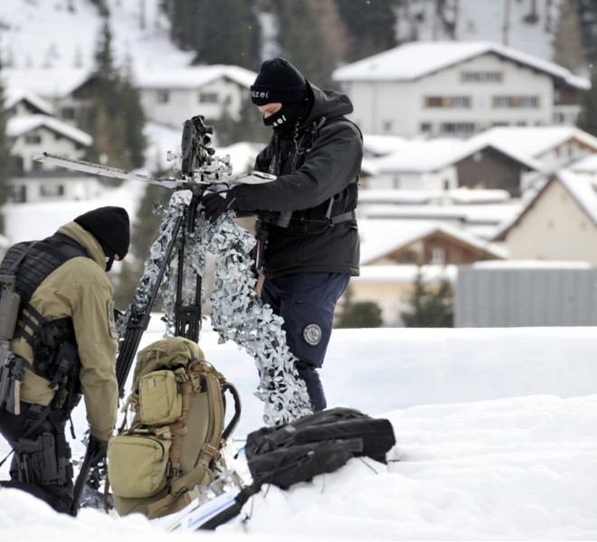"Picture taken on January 24, 2011 shows the Congress Center where the World Economic Forum annual meeting will take place in Davos. Switzerland has mobilised up to 5,000 soldiers to secure the areas surrounding the alpine village of Davos, where world political and economic leaders are to gather this week. AFP PHOTO /JOHANNES EISELE , A sniper of Swiss police stands on top of the Congress Center on January 25, 2011 in Davos where the World Economic Forum annual meeting will take place . Switzerland has mobilised up to 5,000 soldiers to secure the areas surrounding the alpine village of Davos, where world political and economic leaders are to gather this week. AFP PHOTO /JOHANNES EISELE , Staff install a painting inside the Davos' Congress Center ahead of the World Economic Forum annual meeting on January 25, 2011 in Davos. The eurozone's debt battle and the power shift towards emerging giants like China and India will be at the heart of discussions on a ""fundamentally changed world"" at this week's Davos meeting of global elites.    AFP PHOTO / FABRICE COFFRINI , Empty seats are ready at the Davos' Congress Center ahead of the World Economic Forum annual meeting on January 25, 2011 in Davos. The eurozone's debt battle and the power shift towards emerging giants like China and India will be at the heart of discussions on a ""fundamentally changed world"" at this week's Davos meeting of global elites.    AFP PHOTO / FABRICE COFFRINI , A Swiss police sniper stands on the roof of the Congress Center on January 25, 2011 on the eve of the World Economic Forum annual meeting in Davos. Switzerland has mobilized up to 5,000 soldiers to secure the area surrounding the alpine village of Davos, where world political and economic leaders are to gather this week. AFP PHOTO / JOHANNES EISELE , A Swiss police sniper stands on the roof of the Congress Center on January 25, 2011 on the eve of the World Economic Forum annual meeting in Davos. Switzerland has mobilized up to 5,000 soldiers to secure the area surrounding the alpine village of Davos, where world political and economic leaders are to gather this week. AFP PHOTO / JOHANNES EISELE , A woman cleans stairs of the Congress Center on January 25, 2011 on the eve of the World Economic Forum annual meeting in Davos. Switzerland has mobilized up to 5,000 soldiers to secure the area surrounding the alpine village of Davos, where world political and economic leaders are to gather this week. AFP PHOTO / JOHANNES EISELE , A Swiss police sniper stands on the roof of the Belvedere Hotel on January 25, 2011 in Davos. Switzerland has mobilised up to 5,000 soldiers to secure the areas surrounding the alpine village of Davos, where world political and economic leaders are to gather this week.   AFP PHOTO /JOHANNES EISELE , A Swiss police sniper stands on a roof near the Davos Congress center ahead of the World Economic Forum annual meeting on January 25, 2011 in Davos. Switzerland has mobilised up to 5,000 soldiers to secure the areas surrounding the alpine village of Davos, where world political and economic leaders are to gather this week.     AFP PHOTO / FABRICE COFFRINI , Snipers take position on the roof of the Congress Center on January 25, 2011 on the eve of the World Economic Forum annual meeting in Davos. Switzerland has mobilized up to 5,000 soldiers to secure the area surrounding the alpine village of Davos, where world political and economic leaders are to gather this week. AFP PHOTO / FABRICE COFFRINI"