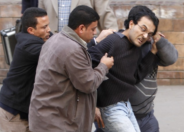 "Egyptian demonstrators clash with Egyptian police in central Cairo during a protest to demand the ouster of President Hosni Mubarak and calling for reforms on January 25, 2011. The protesters, carrying flags and chanting slogans against the government, rallied in a protest inspired by the uprising in Tunisia which led to the ouster of Zine El Abidine Ben Ali.  AFP PHOTO/MOHAMMED ABED , Tear gas smoke fired by Egyptian police is seen as demonstrators gather in central Cairo to demand the ouster of President Hosni Mubarak and calling for reforms on January 25, 2011. The protesters, carrying flags and chanting slogans against the government, rallied in a protest inspired by the uprising in Tunisia which led to the ouster of Zine El Abidine Ben Ali.  AFP PHOTO/MOHAMMED ABED , Egyptian demonstrators attack a water-canon truck used by Egyptian police to disperse a protest in central Cairo to demand the ouster of President Hosni Mubarak and calling for reforms on January 25, 2011. The protesters, carrying flags and chanting slogans against the government, rallied in a protest inspired by the uprising in Tunisia which led to the ouster of Zine El Abidine Ben Ali.  AFP PHOTO/MOHAMMED ABED , Egyptian demonstrators clash with Egyptian police in central Cairo during a protest to demand the ouster of President Hosni Mubarak and calling for reforms on January 25, 2011. The protesters, carrying flags and chanting slogans against the government, rallied in a protest inspired by the uprising in Tunisia which led to the ouster of Zine El Abidine Ben Ali.  AFP PHOTO/MOHAMMED ABED , Egyptian demonstrators hold up placards during a protest in central Cairo to demand the ouster of President Hosni Mubarak and calling for reforms on January 25, 2011. The protesters, carrying flags and chanting slogans against the government, rallied in a protest inspired by the uprising in Tunisia which led to the ouster of Zine El Abidine Ben Ali.  AFP PHOTO/MOHAMMED ABED , Egyptian demonstrators demanding the ouster of President Hosni Mubarak and calling for reforms face riot police in Cairo on January 26, 2011. AFP PHOTO/MOHAMMED ABED , Egyptian demonstrators pray in central Cairo during a protest to demand the ouster of President Hosni Mubarak and calling for reforms on January 25, 2011. Thousands of demonstrators took to the streets of Cairo, facing a massive police presence, to demand the ouster of President Hosni Mubarak in a protest inspired by Tunisia's popular uprising. AFP PHOTO/MOHAMMED ABED , Egyptian demonstrators clash with Egyptian police in central Cairo during a protest to demand the ouster of President Hosni Mubarak and calling for reforms on January 25, 2011. Thousands of demonstrators took to the streets of Cairo, facing a massive police presence, to demand the ouster of President Hosni Mubarak in a protest inspired by Tunisia's popular uprising. AFP PHOTO/MOHAMMED ABED , Egyptian demonstrators shout slogans as they attend a protest in Cairo demanding the ouster of President Hosni Mubarak on January 26, 2011. Egyptian police clashed with protesters in the centre of Cairo and in the port city of Suez, in the second day of nationwide anti-government demonstrations, an AFP reporter and witnesses said.  AFP PHOTO/MOHAMMED ABED , Egyptian demonstrators demanding the ouster of President Hosni Mubarak and calling for reforms clash with riot police in Cairo on January 26, 2011. AFP PHOTO/MOHAMMED ABED , Egyptian demonstrators demanding the ouster of President Hosni Mubarak and calling for reforms face riot police in Cairo on January 26, 2011. AFP PHOTO/MOHAMMED ABED , Egyptian demonstrators demanding the ouster of President Hosni Mubarak and calling for reforms face riot police in Cairo on January 26, 2011. AFP PHOTO/MOHAMMED ABED , Egyptian demonstrators demanding the ouster of President Hosni Mubarak and calling for reforms face riot police in Cairo on January 26, 2011. AFP PHOTO/MOHAMMED ABED , Egyptian demonstrators demanding the ouster of President Hosni Mubarak and calling for reforms face riot police in Cairo on January 26, 2011. AFP PHOTO/MOHAMMED ABED , Egyptian demonstrators demanding the ouster of President Hosni Mubarak and calling for reforms throw object towards riot police in Cairo on January 26, 2011. AFP PHOTO/STR , Egyptian plainclothe police officers arrest a demonstrator demanding the ouster of President Hosni Mubarak during a protest in Cairo on January 26, 2011. Placard in Arabic reads: ""Mr President Leave.""  TOPSHOTS/AFP PHOTO/MOHAMMED ABED"