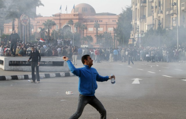 "Egyptian demonstrators clash with Egyptian police in central Cairo during a protest to demand the ouster of President Hosni Mubarak and calling for reforms on January 25, 2011. The protesters, carrying flags and chanting slogans against the government, rallied in a protest inspired by the uprising in Tunisia which led to the ouster of Zine El Abidine Ben Ali.  AFP PHOTO/MOHAMMED ABED , Tear gas smoke fired by Egyptian police is seen as demonstrators gather in central Cairo to demand the ouster of President Hosni Mubarak and calling for reforms on January 25, 2011. The protesters, carrying flags and chanting slogans against the government, rallied in a protest inspired by the uprising in Tunisia which led to the ouster of Zine El Abidine Ben Ali.  AFP PHOTO/MOHAMMED ABED , Egyptian demonstrators attack a water-canon truck used by Egyptian police to disperse a protest in central Cairo to demand the ouster of President Hosni Mubarak and calling for reforms on January 25, 2011. The protesters, carrying flags and chanting slogans against the government, rallied in a protest inspired by the uprising in Tunisia which led to the ouster of Zine El Abidine Ben Ali.  AFP PHOTO/MOHAMMED ABED , Egyptian demonstrators clash with Egyptian police in central Cairo during a protest to demand the ouster of President Hosni Mubarak and calling for reforms on January 25, 2011. The protesters, carrying flags and chanting slogans against the government, rallied in a protest inspired by the uprising in Tunisia which led to the ouster of Zine El Abidine Ben Ali.  AFP PHOTO/MOHAMMED ABED , Egyptian demonstrators hold up placards during a protest in central Cairo to demand the ouster of President Hosni Mubarak and calling for reforms on January 25, 2011. The protesters, carrying flags and chanting slogans against the government, rallied in a protest inspired by the uprising in Tunisia which led to the ouster of Zine El Abidine Ben Ali.  AFP PHOTO/MOHAMMED ABED , Egyptian demonstrators demanding the ouster of President Hosni Mubarak and calling for reforms face riot police in Cairo on January 26, 2011. AFP PHOTO/MOHAMMED ABED , Egyptian demonstrators pray in central Cairo during a protest to demand the ouster of President Hosni Mubarak and calling for reforms on January 25, 2011. Thousands of demonstrators took to the streets of Cairo, facing a massive police presence, to demand the ouster of President Hosni Mubarak in a protest inspired by Tunisia's popular uprising. AFP PHOTO/MOHAMMED ABED , Egyptian demonstrators clash with Egyptian police in central Cairo during a protest to demand the ouster of President Hosni Mubarak and calling for reforms on January 25, 2011. Thousands of demonstrators took to the streets of Cairo, facing a massive police presence, to demand the ouster of President Hosni Mubarak in a protest inspired by Tunisia's popular uprising. AFP PHOTO/MOHAMMED ABED , Egyptian demonstrators shout slogans as they attend a protest in Cairo demanding the ouster of President Hosni Mubarak on January 26, 2011. Egyptian police clashed with protesters in the centre of Cairo and in the port city of Suez, in the second day of nationwide anti-government demonstrations, an AFP reporter and witnesses said.  AFP PHOTO/MOHAMMED ABED , Egyptian demonstrators demanding the ouster of President Hosni Mubarak and calling for reforms clash with riot police in Cairo on January 26, 2011. AFP PHOTO/MOHAMMED ABED , Egyptian demonstrators demanding the ouster of President Hosni Mubarak and calling for reforms face riot police in Cairo on January 26, 2011. AFP PHOTO/MOHAMMED ABED , Egyptian demonstrators demanding the ouster of President Hosni Mubarak and calling for reforms face riot police in Cairo on January 26, 2011. AFP PHOTO/MOHAMMED ABED , Egyptian demonstrators demanding the ouster of President Hosni Mubarak and calling for reforms face riot police in Cairo on January 26, 2011. AFP PHOTO/MOHAMMED ABED , Egyptian demonstrators demanding the ouster of President Hosni Mubarak and calling for reforms face riot police in Cairo on January 26, 2011. AFP PHOTO/MOHAMMED ABED , Egyptian demonstrators demanding the ouster of President Hosni Mubarak and calling for reforms throw object towards riot police in Cairo on January 26, 2011. AFP PHOTO/STR , Egyptian plainclothe police officers arrest a demonstrator demanding the ouster of President Hosni Mubarak during a protest in Cairo on January 26, 2011. Placard in Arabic reads: ""Mr President Leave.""  TOPSHOTS/AFP PHOTO/MOHAMMED ABED , Egyptian riot police gather near burning tires as a demonstrator throws an object towards them during a protest demanding the ouster of President Hosni Mubarak and calling for reforms on January 26, 2011 in Cairo. AFP PHOTO/STR , Egyptian demonstrators demanding the ouster of President Hosni Mubarak and calling for reforms face riot police in Cairo on January 26, 2011. AFP PHOTO/MOHAMMED ABED , Egyptian demonstrators shout slogans during a protest in Cairo demanding the ouster of President Hosni Mubarak on January 26, 2011 in the second day of nationwide anti-government demonstrations, an AFP reporter and witnesses said.  AFP PHOTO/MOHAMMED ABED , Egyptian demonstrators clash with Egyptian police in central Cairo during a protest to demand the ouster of President Hosni Mubarak and calling for reforms on January 25, 2011. Thousands of demonstrators took to the streets of Cairo, facing a massive police presence, to demand the ouster of President Hosni Mubarak in a protest inspired by Tunisia's popular uprising. AFP PHOTO/MOHAMMED ABED , Egyptian demonstrators clash with Egyptian police in central Cairo during a protest to demand the ouster of President Hosni Mubarak and calling for reforms on January 25, 2011. Thousands of demonstrators took to the streets of Cairo, facing a massive police presence, to demand the ouster of President Hosni Mubarak in a protest inspired by Tunisia's popular uprising. AFP PHOTO/MOHAMMED ABED , Egyptian demonstrators protest in central Cairo amidst tear gas fire by Egyptian police to demand the ouster of President Hosni Mubarak and calling for reforms on January 25, 2011. The protesters, carrying flags and chanting slogans against the government, rallied in a protest inspired by the uprising in Tunisia which led to the ouster of Zine El Abidine Ben Ali.  AFP PHOTO/MOHAMMED ABED , Egyptian demonstrators protest in central Cairo to demand the ouster of President Hosni Mubarak and calling for reforms on January 25, 2011. Thousands of demonstrators took to the streets of Cairo, facing a massive police presence, to demand the ouster of President Hosni Mubarak in a protest inspired by Tunisia's popular uprising. AFP PHOTO/MOHAMMED ABED"