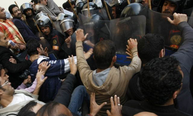 Egyptian demonstrators clash with Egyptian police in central Cairo during a protest to demand the ouster of President Hosni Mubarak and calling for reforms on January 25, 2011. The protesters, carrying flags and chanting slogans against the government, rallied in a protest inspired by the uprising in Tunisia which led to the ouster of Zine El Abidine Ben Ali.  AFP PHOTO/MOHAMMED ABED , Tear gas smoke fired by Egyptian police is seen as demonstrators gather in central Cairo to demand the ouster of President Hosni Mubarak and calling for reforms on January 25, 2011. The protesters, carrying flags and chanting slogans against the government, rallied in a protest inspired by the uprising in Tunisia which led to the ouster of Zine El Abidine Ben Ali.  AFP PHOTO/MOHAMMED ABED , Egyptian demonstrators attack a water-canon truck used by Egyptian police to disperse a protest in central Cairo to demand the ouster of President Hosni Mubarak and calling for reforms on January 25, 2011. The protesters, carrying flags and chanting slogans against the government, rallied in a protest inspired by the uprising in Tunisia which led to the ouster of Zine El Abidine Ben Ali.  AFP PHOTO/MOHAMMED ABED , Egyptian demonstrators clash with Egyptian police in central Cairo during a protest to demand the ouster of President Hosni Mubarak and calling for reforms on January 25, 2011. The protesters, carrying flags and chanting slogans against the government, rallied in a protest inspired by the uprising in Tunisia which led to the ouster of Zine El Abidine Ben Ali.  AFP PHOTO/MOHAMMED ABED , Egyptian demonstrators hold up placards during a protest in central Cairo to demand the ouster of President Hosni Mubarak and calling for reforms on January 25, 2011. The protesters, carrying flags and chanting slogans against the government, rallied in a protest inspired by the uprising in Tunisia which led to the ouster of Zine El Abidine Ben Ali.  AFP PHOTO/MOHAMMED ABED , Egyptian demonstrators demanding the ouster of President Hosni Mubarak and calling for reforms face riot police in Cairo on January 26, 2011. AFP PHOTO/MOHAMMED ABED , Egyptian demonstrators pray in central Cairo during a protest to demand the ouster of President Hosni Mubarak and calling for reforms on January 25, 2011. Thousands of demonstrators took to the streets of Cairo, facing a massive police presence, to demand the ouster of President Hosni Mubarak in a protest inspired by Tunisia's popular uprising. AFP PHOTO/MOHAMMED ABED , Egyptian demonstrators clash with Egyptian police in central Cairo during a protest to demand the ouster of President Hosni Mubarak and calling for reforms on January 25, 2011. Thousands of demonstrators took to the streets of Cairo, facing a massive police presence, to demand the ouster of President Hosni Mubarak in a protest inspired by Tunisia's popular uprising. AFP PHOTO/MOHAMMED ABED , Egyptian demonstrators shout slogans as they attend a protest in Cairo demanding the ouster of President Hosni Mubarak on January 26, 2011. Egyptian police clashed with protesters in the centre of Cairo and in the port city of Suez, in the second day of nationwide anti-government demonstrations, an AFP reporter and witnesses said.  AFP PHOTO/MOHAMMED ABED , Egyptian demonstrators demanding the ouster of President Hosni Mubarak and calling for reforms clash with riot police in Cairo on January 26, 2011. AFP PHOTO/MOHAMMED ABED , Egyptian demonstrators demanding the ouster of President Hosni Mubarak and calling for reforms face riot police in Cairo on January 26, 2011. AFP PHOTO/MOHAMMED ABED , Egyptian demonstrators demanding the ouster of President Hosni Mubarak and calling for reforms face riot police in Cairo on January 26, 2011. AFP PHOTO/MOHAMMED ABED