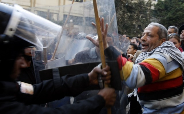 "Egyptian demonstrators clash with Egyptian police in central Cairo during a protest to demand the ouster of President Hosni Mubarak and calling for reforms on January 25, 2011. The protesters, carrying flags and chanting slogans against the government, rallied in a protest inspired by the uprising in Tunisia which led to the ouster of Zine El Abidine Ben Ali.  AFP PHOTO/MOHAMMED ABED , Tear gas smoke fired by Egyptian police is seen as demonstrators gather in central Cairo to demand the ouster of President Hosni Mubarak and calling for reforms on January 25, 2011. The protesters, carrying flags and chanting slogans against the government, rallied in a protest inspired by the uprising in Tunisia which led to the ouster of Zine El Abidine Ben Ali.  AFP PHOTO/MOHAMMED ABED , Egyptian demonstrators attack a water-canon truck used by Egyptian police to disperse a protest in central Cairo to demand the ouster of President Hosni Mubarak and calling for reforms on January 25, 2011. The protesters, carrying flags and chanting slogans against the government, rallied in a protest inspired by the uprising in Tunisia which led to the ouster of Zine El Abidine Ben Ali.  AFP PHOTO/MOHAMMED ABED , Egyptian demonstrators clash with Egyptian police in central Cairo during a protest to demand the ouster of President Hosni Mubarak and calling for reforms on January 25, 2011. The protesters, carrying flags and chanting slogans against the government, rallied in a protest inspired by the uprising in Tunisia which led to the ouster of Zine El Abidine Ben Ali.  AFP PHOTO/MOHAMMED ABED , Egyptian demonstrators hold up placards during a protest in central Cairo to demand the ouster of President Hosni Mubarak and calling for reforms on January 25, 2011. The protesters, carrying flags and chanting slogans against the government, rallied in a protest inspired by the uprising in Tunisia which led to the ouster of Zine El Abidine Ben Ali.  AFP PHOTO/MOHAMMED ABED , Egyptian demonstrators demanding the ouster of President Hosni Mubarak and calling for reforms face riot police in Cairo on January 26, 2011. AFP PHOTO/MOHAMMED ABED , Egyptian demonstrators pray in central Cairo during a protest to demand the ouster of President Hosni Mubarak and calling for reforms on January 25, 2011. Thousands of demonstrators took to the streets of Cairo, facing a massive police presence, to demand the ouster of President Hosni Mubarak in a protest inspired by Tunisia's popular uprising. AFP PHOTO/MOHAMMED ABED , Egyptian demonstrators clash with Egyptian police in central Cairo during a protest to demand the ouster of President Hosni Mubarak and calling for reforms on January 25, 2011. Thousands of demonstrators took to the streets of Cairo, facing a massive police presence, to demand the ouster of President Hosni Mubarak in a protest inspired by Tunisia's popular uprising. AFP PHOTO/MOHAMMED ABED , Egyptian demonstrators shout slogans as they attend a protest in Cairo demanding the ouster of President Hosni Mubarak on January 26, 2011. Egyptian police clashed with protesters in the centre of Cairo and in the port city of Suez, in the second day of nationwide anti-government demonstrations, an AFP reporter and witnesses said.  AFP PHOTO/MOHAMMED ABED , Egyptian demonstrators demanding the ouster of President Hosni Mubarak and calling for reforms clash with riot police in Cairo on January 26, 2011. AFP PHOTO/MOHAMMED ABED , Egyptian demonstrators demanding the ouster of President Hosni Mubarak and calling for reforms face riot police in Cairo on January 26, 2011. AFP PHOTO/MOHAMMED ABED , Egyptian demonstrators demanding the ouster of President Hosni Mubarak and calling for reforms face riot police in Cairo on January 26, 2011. AFP PHOTO/MOHAMMED ABED , Egyptian demonstrators demanding the ouster of President Hosni Mubarak and calling for reforms face riot police in Cairo on January 26, 2011. AFP PHOTO/MOHAMMED ABED , Egyptian demonstrators demanding the ouster of President Hosni Mubarak and calling for reforms face riot police in Cairo on January 26, 2011. AFP PHOTO/MOHAMMED ABED , Egyptian demonstrators demanding the ouster of President Hosni Mubarak and calling for reforms throw object towards riot police in Cairo on January 26, 2011. AFP PHOTO/STR , Egyptian plainclothe police officers arrest a demonstrator demanding the ouster of President Hosni Mubarak during a protest in Cairo on January 26, 2011. Placard in Arabic reads: ""Mr President Leave.""  TOPSHOTS/AFP PHOTO/MOHAMMED ABED , Egyptian riot police gather near burning tires as a demonstrator throws an object towards them during a protest demanding the ouster of President Hosni Mubarak and calling for reforms on January 26, 2011 in Cairo. AFP PHOTO/STR , Egyptian demonstrators demanding the ouster of President Hosni Mubarak and calling for reforms face riot police in Cairo on January 26, 2011. AFP PHOTO/MOHAMMED ABED"