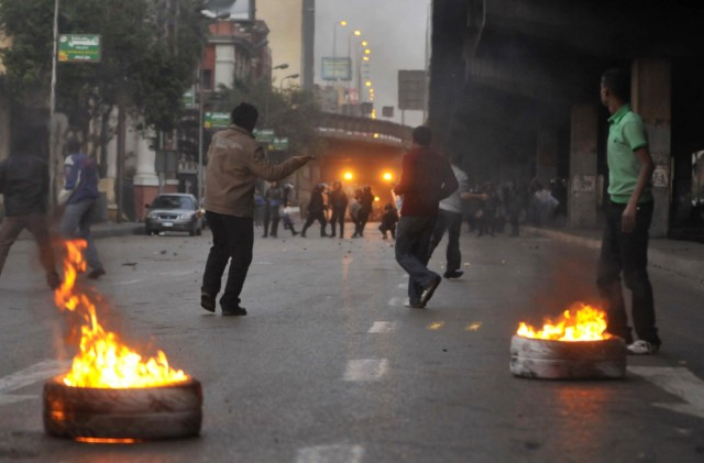 Egyptian demonstrators clash with Egyptian police in central Cairo during a protest to demand the ouster of President Hosni Mubarak and calling for reforms on January 25, 2011. The protesters, carrying flags and chanting slogans against the government, rallied in a protest inspired by the uprising in Tunisia which led to the ouster of Zine El Abidine Ben Ali.  AFP PHOTO/MOHAMMED ABED , Tear gas smoke fired by Egyptian police is seen as demonstrators gather in central Cairo to demand the ouster of President Hosni Mubarak and calling for reforms on January 25, 2011. The protesters, carrying flags and chanting slogans against the government, rallied in a protest inspired by the uprising in Tunisia which led to the ouster of Zine El Abidine Ben Ali.  AFP PHOTO/MOHAMMED ABED , Egyptian demonstrators attack a water-canon truck used by Egyptian police to disperse a protest in central Cairo to demand the ouster of President Hosni Mubarak and calling for reforms on January 25, 2011. The protesters, carrying flags and chanting slogans against the government, rallied in a protest inspired by the uprising in Tunisia which led to the ouster of Zine El Abidine Ben Ali.  AFP PHOTO/MOHAMMED ABED , Egyptian demonstrators clash with Egyptian police in central Cairo during a protest to demand the ouster of President Hosni Mubarak and calling for reforms on January 25, 2011. The protesters, carrying flags and chanting slogans against the government, rallied in a protest inspired by the uprising in Tunisia which led to the ouster of Zine El Abidine Ben Ali.  AFP PHOTO/MOHAMMED ABED , Egyptian demonstrators hold up placards during a protest in central Cairo to demand the ouster of President Hosni Mubarak and calling for reforms on January 25, 2011. The protesters, carrying flags and chanting slogans against the government, rallied in a protest inspired by the uprising in Tunisia which led to the ouster of Zine El Abidine Ben Ali.  AFP PHOTO/MOHAMMED ABED , Egyptian demonstrators demanding the ouster of President Hosni Mubarak and calling for reforms face riot police in Cairo on January 26, 2011. AFP PHOTO/MOHAMMED ABED , Egyptian demonstrators pray in central Cairo during a protest to demand the ouster of President Hosni Mubarak and calling for reforms on January 25, 2011. Thousands of demonstrators took to the streets of Cairo, facing a massive police presence, to demand the ouster of President Hosni Mubarak in a protest inspired by Tunisia's popular uprising. AFP PHOTO/MOHAMMED ABED , Egyptian demonstrators clash with Egyptian police in central Cairo during a protest to demand the ouster of President Hosni Mubarak and calling for reforms on January 25, 2011. Thousands of demonstrators took to the streets of Cairo, facing a massive police presence, to demand the ouster of President Hosni Mubarak in a protest inspired by Tunisia's popular uprising. AFP PHOTO/MOHAMMED ABED , Egyptian demonstrators shout slogans as they attend a protest in Cairo demanding the ouster of President Hosni Mubarak on January 26, 2011. Egyptian police clashed with protesters in the centre of Cairo and in the port city of Suez, in the second day of nationwide anti-government demonstrations, an AFP reporter and witnesses said.  AFP PHOTO/MOHAMMED ABED , Egyptian demonstrators demanding the ouster of President Hosni Mubarak and calling for reforms clash with riot police in Cairo on January 26, 2011. AFP PHOTO/MOHAMMED ABED , Egyptian demonstrators demanding the ouster of President Hosni Mubarak and calling for reforms face riot police in Cairo on January 26, 2011. AFP PHOTO/MOHAMMED ABED , Egyptian demonstrators demanding the ouster of President Hosni Mubarak and calling for reforms face riot police in Cairo on January 26, 2011. AFP PHOTO/MOHAMMED ABED , Egyptian demonstrators demanding the ouster of President Hosni Mubarak and calling for reforms face riot police in Cairo on January 26, 2011. AFP PHOTO/MOHAMMED ABED , Egyptian demonstrators demanding the ouster of President Hosni Mubarak and calling for reforms face riot police in Cairo on January 26, 2011. AFP PHOTO/MOHAMMED ABED , Egyptian demonstrators demanding the ouster of President Hosni Mubarak and calling for reforms throw object towards riot police in Cairo on January 26, 2011. AFP PHOTO/STR
