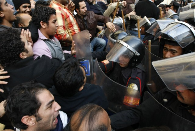 Egyptian demonstrators clash with Egyptian police in central Cairo during a protest to demand the ouster of President Hosni Mubarak and calling for reforms on January 25, 2011. The protesters, carrying flags and chanting slogans against the government, rallied in a protest inspired by the uprising in Tunisia which led to the ouster of Zine El Abidine Ben Ali.  AFP PHOTO/MOHAMMED ABED , Tear gas smoke fired by Egyptian police is seen as demonstrators gather in central Cairo to demand the ouster of President Hosni Mubarak and calling for reforms on January 25, 2011. The protesters, carrying flags and chanting slogans against the government, rallied in a protest inspired by the uprising in Tunisia which led to the ouster of Zine El Abidine Ben Ali.  AFP PHOTO/MOHAMMED ABED , Egyptian demonstrators attack a water-canon truck used by Egyptian police to disperse a protest in central Cairo to demand the ouster of President Hosni Mubarak and calling for reforms on January 25, 2011. The protesters, carrying flags and chanting slogans against the government, rallied in a protest inspired by the uprising in Tunisia which led to the ouster of Zine El Abidine Ben Ali.  AFP PHOTO/MOHAMMED ABED , Egyptian demonstrators clash with Egyptian police in central Cairo during a protest to demand the ouster of President Hosni Mubarak and calling for reforms on January 25, 2011. The protesters, carrying flags and chanting slogans against the government, rallied in a protest inspired by the uprising in Tunisia which led to the ouster of Zine El Abidine Ben Ali.  AFP PHOTO/MOHAMMED ABED , Egyptian demonstrators hold up placards during a protest in central Cairo to demand the ouster of President Hosni Mubarak and calling for reforms on January 25, 2011. The protesters, carrying flags and chanting slogans against the government, rallied in a protest inspired by the uprising in Tunisia which led to the ouster of Zine El Abidine Ben Ali.  AFP PHOTO/MOHAMMED ABED , Egyptian demonstrators demanding the ouster of President Hosni Mubarak and calling for reforms face riot police in Cairo on January 26, 2011. AFP PHOTO/MOHAMMED ABED