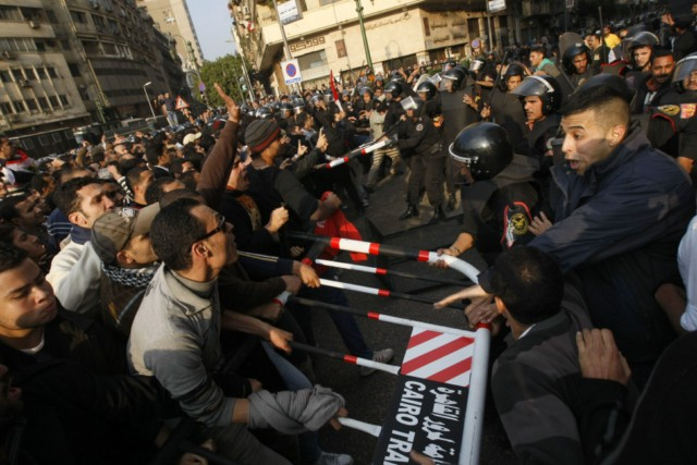 Egyptian demonstrators clash with Egyptian police in central Cairo during a protest to demand the ouster of President Hosni Mubarak and calling for reforms on January 25, 2011. The protesters, carrying flags and chanting slogans against the government, rallied in a protest inspired by the uprising in Tunisia which led to the ouster of Zine El Abidine Ben Ali.  AFP PHOTO/MOHAMMED ABED , Tear gas smoke fired by Egyptian police is seen as demonstrators gather in central Cairo to demand the ouster of President Hosni Mubarak and calling for reforms on January 25, 2011. The protesters, carrying flags and chanting slogans against the government, rallied in a protest inspired by the uprising in Tunisia which led to the ouster of Zine El Abidine Ben Ali.  AFP PHOTO/MOHAMMED ABED , Egyptian demonstrators attack a water-canon truck used by Egyptian police to disperse a protest in central Cairo to demand the ouster of President Hosni Mubarak and calling for reforms on January 25, 2011. The protesters, carrying flags and chanting slogans against the government, rallied in a protest inspired by the uprising in Tunisia which led to the ouster of Zine El Abidine Ben Ali.  AFP PHOTO/MOHAMMED ABED , Egyptian demonstrators clash with Egyptian police in central Cairo during a protest to demand the ouster of President Hosni Mubarak and calling for reforms on January 25, 2011. The protesters, carrying flags and chanting slogans against the government, rallied in a protest inspired by the uprising in Tunisia which led to the ouster of Zine El Abidine Ben Ali.  AFP PHOTO/MOHAMMED ABED