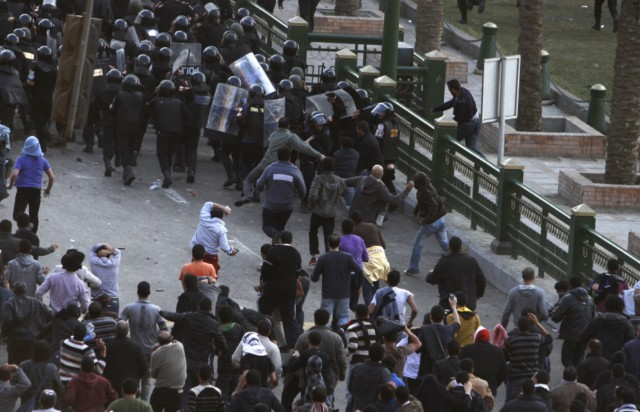 Egyptian demonstrators clash with Egyptian police in central Cairo during a protest to demand the ouster of President Hosni Mubarak and calling for reforms on January 25, 2011. The protesters, carrying flags and chanting slogans against the government, rallied in a protest inspired by the uprising in Tunisia which led to the ouster of Zine El Abidine Ben Ali.  AFP PHOTO/MOHAMMED ABED , Tear gas smoke fired by Egyptian police is seen as demonstrators gather in central Cairo to demand the ouster of President Hosni Mubarak and calling for reforms on January 25, 2011. The protesters, carrying flags and chanting slogans against the government, rallied in a protest inspired by the uprising in Tunisia which led to the ouster of Zine El Abidine Ben Ali.  AFP PHOTO/MOHAMMED ABED , Egyptian demonstrators attack a water-canon truck used by Egyptian police to disperse a protest in central Cairo to demand the ouster of President Hosni Mubarak and calling for reforms on January 25, 2011. The protesters, carrying flags and chanting slogans against the government, rallied in a protest inspired by the uprising in Tunisia which led to the ouster of Zine El Abidine Ben Ali.  AFP PHOTO/MOHAMMED ABED , Egyptian demonstrators clash with Egyptian police in central Cairo during a protest to demand the ouster of President Hosni Mubarak and calling for reforms on January 25, 2011. The protesters, carrying flags and chanting slogans against the government, rallied in a protest inspired by the uprising in Tunisia which led to the ouster of Zine El Abidine Ben Ali.  AFP PHOTO/MOHAMMED ABED , Egyptian demonstrators hold up placards during a protest in central Cairo to demand the ouster of President Hosni Mubarak and calling for reforms on January 25, 2011. The protesters, carrying flags and chanting slogans against the government, rallied in a protest inspired by the uprising in Tunisia which led to the ouster of Zine El Abidine Ben Ali.  AFP PHOTO/MOHAMMED ABED , Egyptian demonstrators demanding the ouster of President Hosni Mubarak and calling for reforms face riot police in Cairo on January 26, 2011. AFP PHOTO/MOHAMMED ABED , Egyptian demonstrators pray in central Cairo during a protest to demand the ouster of President Hosni Mubarak and calling for reforms on January 25, 2011. Thousands of demonstrators took to the streets of Cairo, facing a massive police presence, to demand the ouster of President Hosni Mubarak in a protest inspired by Tunisia's popular uprising. AFP PHOTO/MOHAMMED ABED , Egyptian demonstrators clash with Egyptian police in central Cairo during a protest to demand the ouster of President Hosni Mubarak and calling for reforms on January 25, 2011. Thousands of demonstrators took to the streets of Cairo, facing a massive police presence, to demand the ouster of President Hosni Mubarak in a protest inspired by Tunisia's popular uprising. AFP PHOTO/MOHAMMED ABED