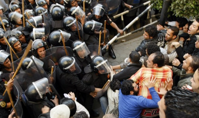 Egyptian demonstrators clash with Egyptian police in central Cairo during a protest to demand the ouster of President Hosni Mubarak and calling for reforms on January 25, 2011. The protesters, carrying flags and chanting slogans against the government, rallied in a protest inspired by the uprising in Tunisia which led to the ouster of Zine El Abidine Ben Ali.  AFP PHOTO/MOHAMMED ABED , Tear gas smoke fired by Egyptian police is seen as demonstrators gather in central Cairo to demand the ouster of President Hosni Mubarak and calling for reforms on January 25, 2011. The protesters, carrying flags and chanting slogans against the government, rallied in a protest inspired by the uprising in Tunisia which led to the ouster of Zine El Abidine Ben Ali.  AFP PHOTO/MOHAMMED ABED , Egyptian demonstrators attack a water-canon truck used by Egyptian police to disperse a protest in central Cairo to demand the ouster of President Hosni Mubarak and calling for reforms on January 25, 2011. The protesters, carrying flags and chanting slogans against the government, rallied in a protest inspired by the uprising in Tunisia which led to the ouster of Zine El Abidine Ben Ali.  AFP PHOTO/MOHAMMED ABED , Egyptian demonstrators clash with Egyptian police in central Cairo during a protest to demand the ouster of President Hosni Mubarak and calling for reforms on January 25, 2011. The protesters, carrying flags and chanting slogans against the government, rallied in a protest inspired by the uprising in Tunisia which led to the ouster of Zine El Abidine Ben Ali.  AFP PHOTO/MOHAMMED ABED , Egyptian demonstrators hold up placards during a protest in central Cairo to demand the ouster of President Hosni Mubarak and calling for reforms on January 25, 2011. The protesters, carrying flags and chanting slogans against the government, rallied in a protest inspired by the uprising in Tunisia which led to the ouster of Zine El Abidine Ben Ali.  AFP PHOTO/MOHAMMED ABED , Egyptian demonstrators demanding the ouster of President Hosni Mubarak and calling for reforms face riot police in Cairo on January 26, 2011. AFP PHOTO/MOHAMMED ABED , Egyptian demonstrators pray in central Cairo during a protest to demand the ouster of President Hosni Mubarak and calling for reforms on January 25, 2011. Thousands of demonstrators took to the streets of Cairo, facing a massive police presence, to demand the ouster of President Hosni Mubarak in a protest inspired by Tunisia's popular uprising. AFP PHOTO/MOHAMMED ABED , Egyptian demonstrators clash with Egyptian police in central Cairo during a protest to demand the ouster of President Hosni Mubarak and calling for reforms on January 25, 2011. Thousands of demonstrators took to the streets of Cairo, facing a massive police presence, to demand the ouster of President Hosni Mubarak in a protest inspired by Tunisia's popular uprising. AFP PHOTO/MOHAMMED ABED , Egyptian demonstrators shout slogans as they attend a protest in Cairo demanding the ouster of President Hosni Mubarak on January 26, 2011. Egyptian police clashed with protesters in the centre of Cairo and in the port city of Suez, in the second day of nationwide anti-government demonstrations, an AFP reporter and witnesses said.  AFP PHOTO/MOHAMMED ABED , Egyptian demonstrators demanding the ouster of President Hosni Mubarak and calling for reforms clash with riot police in Cairo on January 26, 2011. AFP PHOTO/MOHAMMED ABED