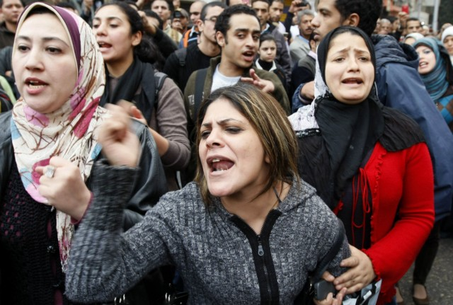 Egyptian demonstrators clash with Egyptian police in central Cairo during a protest to demand the ouster of President Hosni Mubarak and calling for reforms on January 25, 2011. The protesters, carrying flags and chanting slogans against the government, rallied in a protest inspired by the uprising in Tunisia which led to the ouster of Zine El Abidine Ben Ali.  AFP PHOTO/MOHAMMED ABED , Tear gas smoke fired by Egyptian police is seen as demonstrators gather in central Cairo to demand the ouster of President Hosni Mubarak and calling for reforms on January 25, 2011. The protesters, carrying flags and chanting slogans against the government, rallied in a protest inspired by the uprising in Tunisia which led to the ouster of Zine El Abidine Ben Ali.  AFP PHOTO/MOHAMMED ABED , Egyptian demonstrators attack a water-canon truck used by Egyptian police to disperse a protest in central Cairo to demand the ouster of President Hosni Mubarak and calling for reforms on January 25, 2011. The protesters, carrying flags and chanting slogans against the government, rallied in a protest inspired by the uprising in Tunisia which led to the ouster of Zine El Abidine Ben Ali.  AFP PHOTO/MOHAMMED ABED , Egyptian demonstrators clash with Egyptian police in central Cairo during a protest to demand the ouster of President Hosni Mubarak and calling for reforms on January 25, 2011. The protesters, carrying flags and chanting slogans against the government, rallied in a protest inspired by the uprising in Tunisia which led to the ouster of Zine El Abidine Ben Ali.  AFP PHOTO/MOHAMMED ABED , Egyptian demonstrators hold up placards during a protest in central Cairo to demand the ouster of President Hosni Mubarak and calling for reforms on January 25, 2011. The protesters, carrying flags and chanting slogans against the government, rallied in a protest inspired by the uprising in Tunisia which led to the ouster of Zine El Abidine Ben Ali.  AFP PHOTO/MOHAMMED ABED , Egyptian demonstrators demanding the ouster of President Hosni Mubarak and calling for reforms face riot police in Cairo on January 26, 2011. AFP PHOTO/MOHAMMED ABED , Egyptian demonstrators pray in central Cairo during a protest to demand the ouster of President Hosni Mubarak and calling for reforms on January 25, 2011. Thousands of demonstrators took to the streets of Cairo, facing a massive police presence, to demand the ouster of President Hosni Mubarak in a protest inspired by Tunisia's popular uprising. AFP PHOTO/MOHAMMED ABED , Egyptian demonstrators clash with Egyptian police in central Cairo during a protest to demand the ouster of President Hosni Mubarak and calling for reforms on January 25, 2011. Thousands of demonstrators took to the streets of Cairo, facing a massive police presence, to demand the ouster of President Hosni Mubarak in a protest inspired by Tunisia's popular uprising. AFP PHOTO/MOHAMMED ABED , Egyptian demonstrators shout slogans as they attend a protest in Cairo demanding the ouster of President Hosni Mubarak on January 26, 2011. Egyptian police clashed with protesters in the centre of Cairo and in the port city of Suez, in the second day of nationwide anti-government demonstrations, an AFP reporter and witnesses said.  AFP PHOTO/MOHAMMED ABED