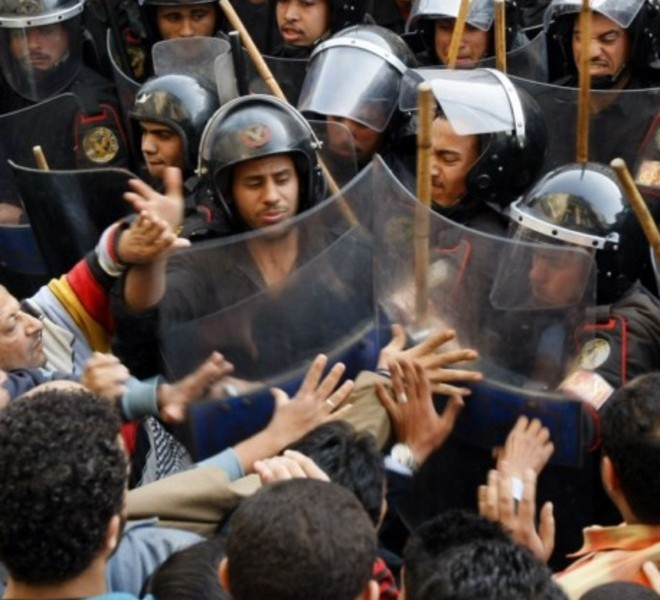 Egyptian demonstrators clash with Egyptian police in central Cairo during a protest to demand the ouster of President Hosni Mubarak and calling for reforms on January 25, 2011. The protesters, carrying flags and chanting slogans against the government, rallied in a protest inspired by the uprising in Tunisia which led to the ouster of Zine El Abidine Ben Ali.  AFP PHOTO/MOHAMMED ABED , Tear gas smoke fired by Egyptian police is seen as demonstrators gather in central Cairo to demand the ouster of President Hosni Mubarak and calling for reforms on January 25, 2011. The protesters, carrying flags and chanting slogans against the government, rallied in a protest inspired by the uprising in Tunisia which led to the ouster of Zine El Abidine Ben Ali.  AFP PHOTO/MOHAMMED ABED , Egyptian demonstrators attack a water-canon truck used by Egyptian police to disperse a protest in central Cairo to demand the ouster of President Hosni Mubarak and calling for reforms on January 25, 2011. The protesters, carrying flags and chanting slogans against the government, rallied in a protest inspired by the uprising in Tunisia which led to the ouster of Zine El Abidine Ben Ali.  AFP PHOTO/MOHAMMED ABED , Egyptian demonstrators clash with Egyptian police in central Cairo during a protest to demand the ouster of President Hosni Mubarak and calling for reforms on January 25, 2011. The protesters, carrying flags and chanting slogans against the government, rallied in a protest inspired by the uprising in Tunisia which led to the ouster of Zine El Abidine Ben Ali.  AFP PHOTO/MOHAMMED ABED , Egyptian demonstrators hold up placards during a protest in central Cairo to demand the ouster of President Hosni Mubarak and calling for reforms on January 25, 2011. The protesters, carrying flags and chanting slogans against the government, rallied in a protest inspired by the uprising in Tunisia which led to the ouster of Zine El Abidine Ben Ali.  AFP PHOTO/MOHAMMED ABED , Egyptian demonstrators demanding the ouster of President Hosni Mubarak and calling for reforms face riot police in Cairo on January 26, 2011. AFP PHOTO/MOHAMMED ABED , Egyptian demonstrators pray in central Cairo during a protest to demand the ouster of President Hosni Mubarak and calling for reforms on January 25, 2011. Thousands of demonstrators took to the streets of Cairo, facing a massive police presence, to demand the ouster of President Hosni Mubarak in a protest inspired by Tunisia's popular uprising. AFP PHOTO/MOHAMMED ABED , Egyptian demonstrators clash with Egyptian police in central Cairo during a protest to demand the ouster of President Hosni Mubarak and calling for reforms on January 25, 2011. Thousands of demonstrators took to the streets of Cairo, facing a massive police presence, to demand the ouster of President Hosni Mubarak in a protest inspired by Tunisia's popular uprising. AFP PHOTO/MOHAMMED ABED , Egyptian demonstrators shout slogans as they attend a protest in Cairo demanding the ouster of President Hosni Mubarak on January 26, 2011. Egyptian police clashed with protesters in the centre of Cairo and in the port city of Suez, in the second day of nationwide anti-government demonstrations, an AFP reporter and witnesses said.  AFP PHOTO/MOHAMMED ABED , Egyptian demonstrators demanding the ouster of President Hosni Mubarak and calling for reforms clash with riot police in Cairo on January 26, 2011. AFP PHOTO/MOHAMMED ABED , Egyptian demonstrators demanding the ouster of President Hosni Mubarak and calling for reforms face riot police in Cairo on January 26, 2011. AFP PHOTO/MOHAMMED ABED