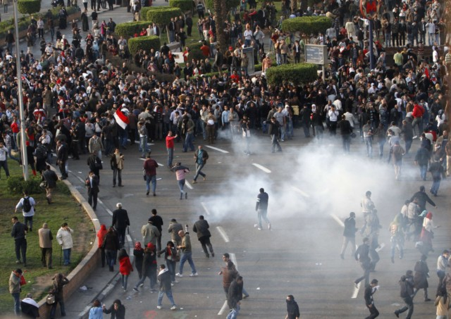 "Egyptian demonstrators clash with Egyptian police in central Cairo during a protest to demand the ouster of President Hosni Mubarak and calling for reforms on January 25, 2011. The protesters, carrying flags and chanting slogans against the government, rallied in a protest inspired by the uprising in Tunisia which led to the ouster of Zine El Abidine Ben Ali.  AFP PHOTO/MOHAMMED ABED , Tear gas smoke fired by Egyptian police is seen as demonstrators gather in central Cairo to demand the ouster of President Hosni Mubarak and calling for reforms on January 25, 2011. The protesters, carrying flags and chanting slogans against the government, rallied in a protest inspired by the uprising in Tunisia which led to the ouster of Zine El Abidine Ben Ali.  AFP PHOTO/MOHAMMED ABED , Egyptian demonstrators attack a water-canon truck used by Egyptian police to disperse a protest in central Cairo to demand the ouster of President Hosni Mubarak and calling for reforms on January 25, 2011. The protesters, carrying flags and chanting slogans against the government, rallied in a protest inspired by the uprising in Tunisia which led to the ouster of Zine El Abidine Ben Ali.  AFP PHOTO/MOHAMMED ABED , Egyptian demonstrators clash with Egyptian police in central Cairo during a protest to demand the ouster of President Hosni Mubarak and calling for reforms on January 25, 2011. The protesters, carrying flags and chanting slogans against the government, rallied in a protest inspired by the uprising in Tunisia which led to the ouster of Zine El Abidine Ben Ali.  AFP PHOTO/MOHAMMED ABED , Egyptian demonstrators hold up placards during a protest in central Cairo to demand the ouster of President Hosni Mubarak and calling for reforms on January 25, 2011. The protesters, carrying flags and chanting slogans against the government, rallied in a protest inspired by the uprising in Tunisia which led to the ouster of Zine El Abidine Ben Ali.  AFP PHOTO/MOHAMMED ABED , Egyptian demonstrators demanding the ouster of President Hosni Mubarak and calling for reforms face riot police in Cairo on January 26, 2011. AFP PHOTO/MOHAMMED ABED , Egyptian demonstrators pray in central Cairo during a protest to demand the ouster of President Hosni Mubarak and calling for reforms on January 25, 2011. Thousands of demonstrators took to the streets of Cairo, facing a massive police presence, to demand the ouster of President Hosni Mubarak in a protest inspired by Tunisia's popular uprising. AFP PHOTO/MOHAMMED ABED , Egyptian demonstrators clash with Egyptian police in central Cairo during a protest to demand the ouster of President Hosni Mubarak and calling for reforms on January 25, 2011. Thousands of demonstrators took to the streets of Cairo, facing a massive police presence, to demand the ouster of President Hosni Mubarak in a protest inspired by Tunisia's popular uprising. AFP PHOTO/MOHAMMED ABED , Egyptian demonstrators shout slogans as they attend a protest in Cairo demanding the ouster of President Hosni Mubarak on January 26, 2011. Egyptian police clashed with protesters in the centre of Cairo and in the port city of Suez, in the second day of nationwide anti-government demonstrations, an AFP reporter and witnesses said.  AFP PHOTO/MOHAMMED ABED , Egyptian demonstrators demanding the ouster of President Hosni Mubarak and calling for reforms clash with riot police in Cairo on January 26, 2011. AFP PHOTO/MOHAMMED ABED , Egyptian demonstrators demanding the ouster of President Hosni Mubarak and calling for reforms face riot police in Cairo on January 26, 2011. AFP PHOTO/MOHAMMED ABED , Egyptian demonstrators demanding the ouster of President Hosni Mubarak and calling for reforms face riot police in Cairo on January 26, 2011. AFP PHOTO/MOHAMMED ABED , Egyptian demonstrators demanding the ouster of President Hosni Mubarak and calling for reforms face riot police in Cairo on January 26, 2011. AFP PHOTO/MOHAMMED ABED , Egyptian demonstrators demanding the ouster of President Hosni Mubarak and calling for reforms face riot police in Cairo on January 26, 2011. AFP PHOTO/MOHAMMED ABED , Egyptian demonstrators demanding the ouster of President Hosni Mubarak and calling for reforms throw object towards riot police in Cairo on January 26, 2011. AFP PHOTO/STR , Egyptian plainclothe police officers arrest a demonstrator demanding the ouster of President Hosni Mubarak during a protest in Cairo on January 26, 2011. Placard in Arabic reads: ""Mr President Leave.""  TOPSHOTS/AFP PHOTO/MOHAMMED ABED , Egyptian riot police gather near burning tires as a demonstrator throws an object towards them during a protest demanding the ouster of President Hosni Mubarak and calling for reforms on January 26, 2011 in Cairo. AFP PHOTO/STR , Egyptian demonstrators demanding the ouster of President Hosni Mubarak and calling for reforms face riot police in Cairo on January 26, 2011. AFP PHOTO/MOHAMMED ABED , Egyptian demonstrators shout slogans during a protest in Cairo demanding the ouster of President Hosni Mubarak on January 26, 2011 in the second day of nationwide anti-government demonstrations, an AFP reporter and witnesses said.  AFP PHOTO/MOHAMMED ABED , Egyptian demonstrators clash with Egyptian police in central Cairo during a protest to demand the ouster of President Hosni Mubarak and calling for reforms on January 25, 2011. Thousands of demonstrators took to the streets of Cairo, facing a massive police presence, to demand the ouster of President Hosni Mubarak in a protest inspired by Tunisia's popular uprising. AFP PHOTO/MOHAMMED ABED , Egyptian demonstrators clash with Egyptian police in central Cairo during a protest to demand the ouster of President Hosni Mubarak and calling for reforms on January 25, 2011. Thousands of demonstrators took to the streets of Cairo, facing a massive police presence, to demand the ouster of President Hosni Mubarak in a protest inspired by Tunisia's popular uprising. AFP PHOTO/MOHAMMED ABED , Egyptian demonstrators protest in central Cairo amidst tear gas fire by Egyptian police to demand the ouster of President Hosni Mubarak and calling for reforms on January 25, 2011. The protesters, carrying flags and chanting slogans against the government, rallied in a protest inspired by the uprising in Tunisia which led to the ouster of Zine El Abidine Ben Ali.  AFP PHOTO/MOHAMMED ABED"