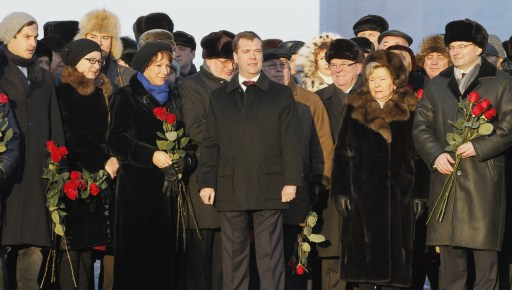 Russian President Dmitry Medvedev (C) attends an opening ceremony of a monument to former Russia's president Boris Yeltsin in Yekaterinburg on February 1, 2011, flanked by Yeltsin's relatives and officials. Medvedev hailed Boris Yeltsin on the late leader's 80th birthday as a visionary who stared down Communism and absorbed the country's ire during subsequent years of pain. Yeltsin died at the age of 76 in 2007 with opinion still divided about his achievements as the country's first post-Soviet president.       AFP PHOTO/ RIA-NOVOSTI/ KREMLIN/ DMITRY ASTAKHOV
