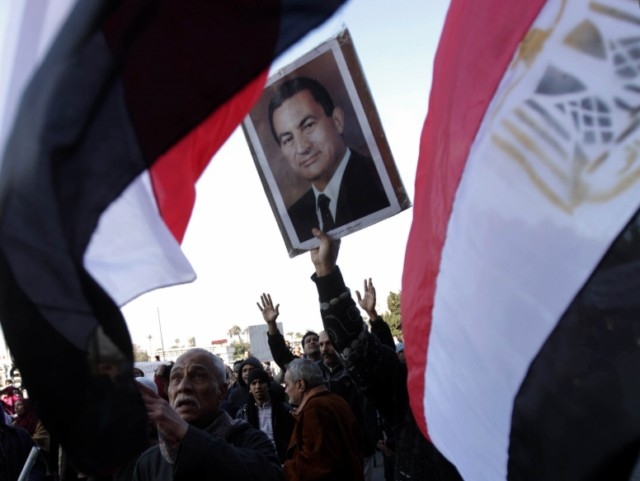 "Egyptian demonstrators demanding the ouster of Egyptian President Hosmi Mubarak watch his televised speech in Cairo's Tahrir Square on February 1, 2011. Egyptian President Hosni Mubarak said on Tuesday he will not seek re-election in September but rejected demands that brought a million people on to the streets around the country that he quit immediately. AFP PHOT0/PATRICK BAZ , An Egyptian women demanding the ouster of Egyptian President Hosmi Mubarak chant in Cairo's Tahrir square during his televised speech on February 1, 2011.  Egyptian President Hosni Mubarak said on Tuesday he will not seek re-election in September but rejected demands that brought a million people on to the streets around the country that he quit immediately. AFP PHOT0/MIGUEL MEDINA , Egyptian demonstrators demanding the ouster of Egyptian  President Hosmi Mubarak brandish their shoes shouting ""we will kick you out with our boots"" in Cairo's Tahrir square during his televised speech on February 1, 2011. Egyptian President Hosni Mubarak said on Tuesday he will not seek re-election in September but rejected demands that brought a million people on to the streets around the country that he quit immediately. AFP PHOT0/PATRICK BAZ , Egyptian demonstrators demanding the ouster of Egyptian  President Hosmi Mubarak listen to his televised speech as they camp in Cairo's Tahrir square on February 1, 2011. Egyptian President Hosni Mubarak said on Tuesday he will not seek re-election in September but rejected demands that brought a million people on to the streets around the country that he quit immediately. AFP PHOT0/PATRICK BAZ , Supporters of Egyptian President Hosni Mubarak shout slogans during a rally to show their allegiance for the embattled leader in Cairo on February 2, 2011. AFP PHOTO/MARCO LONGARI , Supporters of Egyptian President Hosni Mubarak shout slogans during a rally to show their allegiance for the embattled leader in Cairo on February 2, 2011. AFP PHOTO/PATRICK BAZ , Supprters of Egyptian President Hosni Mubarak (picture) rally to show their allegiance for the embattled leader in Cairo on February 2, 2011. AFP PHOTO/PATRICK BAZ , Supprters of Egyptian President Hosni Mubarak hold a banner that reads in Arabic ""Yes to Mubarak"" during a rally vowing allegiance for the embattled leader in Cairo on February 2, 2011. AFP PHOTO/PATRICK BAZ , Supprters of Egyptian President Hosni Mubarak (portrait) take part in a rally vowing allegiance for the embattled leader in Cairo on February 2, 2011. AFP PHOTO/PATRICK BAZ , Egyptians rally in support of President Hosni Mubarak in Cairo on February 2, 2011. AFP PHOTO/PATRICK BAZ , Supporters of Egyptian President Hosni Mubarak (picture) wave their national flag as they hold a rally in support of the veteran leader in Cairo on February 2, 2011. AFP PHOTO/PATRICK BAZ"