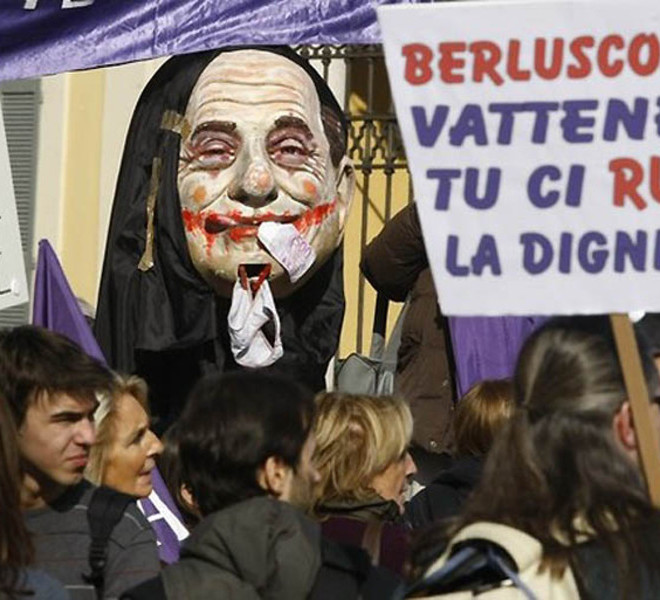 "Protesters attend a protest against Italian Prime Minister Silvio Berlusconi in Arcore, near Milan, February 6, 2011. The banner reads, ""Berlusconi go away! You steal our dignity!""  REUTERS/Alessandro Garofalo.  (ITALY - Tags: POLITICS CIVIL UNREST)"