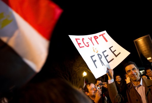 Egyptians celebrate the ouster of Egyptian President Hosni Mubarak in front of the Egyptian embassy in Washington on February 11, 2011. Mubarak resigned after 18 days of protest against his 30-year authoritarian rule.      AFP PHOTO/Nicholas KAMM