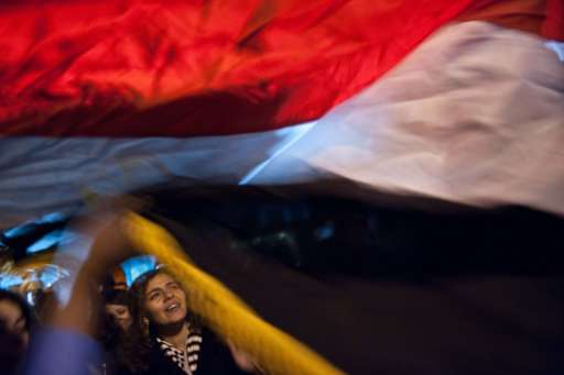 Egyptians celebrate the ouster of Egyptisan President Hosni Mubarak in front of the Egyptian embassy in Washington on February 11, 2011. Mubarak resigned after 18 days of protests against his 30-year authoritarian rule.      AFP PHOTO/Nicholas KAMM