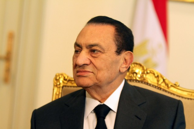 "EDITOR'S NOTE - RESTRICTED TO EDITORIAL USE - MANDATORY CREDIT ""AFP PHOTO / AL-MASRIYA TV"" - NO MARKETING NO ADVERTISING CAMPAIGNS - DISTRIBUTED AS A SERVICE TO CLIENTS An image grab taken from Egyptian state televsion Al-Masriya on February 10, 2011 from an undated footage shows Egyptian President Hosni Mubarak (L) meeting with Vice President Omar Suleiman in Cairo. AFP PHOTO / AL-MASRIYA TV , (FILES) -- File picture dated June 23, 2010 shows Egyptian president Hosni Mubarak during an official meeting at the presidential palace in Cairo. Mubarak said in a televised speech on February 10, 2011 that he would hand over power to his deputy and former intelligence chief Omar Suleiman. AFP PHOTO/KHALED DESOUKI , (FILES) -- In this combo of file pictures, Egyptian President Hosni Mubarak (R) is seen during an official meeting at the presidential palace in Cairo on February 9, 2011 and his deputy Omar Suleiman is pictured on September 20, 2007 during a press briefing in the Egyptian capital. The embattled Egyptian leader delegated on February 10, 2011 power to Suleiman, the former intelligence chief, and proposed constitutional reforms. AFP PHOTO / CRIS BOURONCLE / KHALED DESOUKI , (FILES) -- File picture dated February 20, 2003 shows Egyptian President Hosni Mubarak and his wife, Suzanne upon their arrival at the Palais de l'Elys?e in Paris before an official diner. The embattled Egyptian president left Cairo with his family on February 11, 2011, a source close to the government told AFP, but his destination was not immediately clear.         AFP PHOTO/JACK GUEZ , Egyptian anti-goverment demonstrators shout slogans against President Hosni Mubarak at Cairo's Tahrir Square on February 10, 2011, on the 17th day of protests against President Hosni Mubarak's regime. Thousands more Egyptian demonstrators joined a mounting tide of protest against Mubarak's regime despite stark threats of a government crackdown. AFP PHOTO/PEDRO UGARTE , Egyptian anti-goverment demonstrators pray and read newspapers in front of military vehicles in Cairo's landmark Tahrir Square in the early hours of February 11, 2011, as the 18th day of protests against President Hosni Mubarak's regime beings with furious Egyptian protesters vowing to step up their revolt after Mubarak refused to quit office. Arabic graffiti on armoured vehicle (R) reads: ""Down with Mubarak.. No to Mubarak and no to Suleiman"", in reference to Vice President Amr Suleiman.  AFP PHOTO/PEDRO UGARTE , An Egyptian anti-goverment protester reads a newspaper as he rests against an army tank positioned in Cairo's landmark Tahrir Square in the early hours of February 11, 2011, as the 18th day of protests against President Hosni Mubarak's regime beings with furious Egyptian protesters vowing to step up their revolt after Mubarak refused to quit office.   AFP PHOTO/PEDRO UGARTE , Egyptian anti-goverment demonstrators flood Cairo's landmark Tahrir Square early on February 11, 2011, the 18th day of protests against President Hosni Mubarak who refused to quit office in a much-awaited speech the previous night.   AFP PHOTO/PEDRO UGARTE , Egyptian anti-goverment protestors carry a man who fainted while performing the Friday noon prayer during protests in Cairo's landmark Tahrir Square on February 11, 2011. Tens of thousands of demonstrators reacted with fury after the military threw its weight behind President Mubarak's attempt to cling on to power despite massive nationwide protests over the past 18 days.   AFP PHOTO/PEDRO UGARTE , Egyptian anti-goverment demonstrators shout slogans against President Hosni Mubarak's regime during protests in Cairo's landmark Tahrir Square on February 11, 2011, as anti-Mubarak protesters reacted with fury after the military threw its weight behind his attempt to cling on to power despite massive nationwide protests over the past 18 days.   AFP PHOTO/PEDRO UGARTE , Egyptian anti-government protestors demonstrate raising their shoes in front of the Egyptian national TV building, which is currently secured by the Egyptian Army, in central Cairo on February 11, 2011. Egyptian demonstrators reacted with fury after the military threw its weight behind President Mubarak's attempt to cling on to power despite massive nationwide protests. AFP PHOTO/MARCO LONGARI , Egyptian anti-goverment demonstrators carry on with their protest in Cairo's landmark Tahrir Square on February 11, 2011, after the military threw its weight behind President Mubarak's attempt to cling on to power despite massive nationwide protests over the past 18 days.   AFP PHOTO/PATRICK BAZ , Egyptian soldiers guard the national TV building in Cairo as anti-government demonstrators wave national flags during continuing protests on February 11, 2011 after the military threw its weight behind President Mubarak's attempt to cling on to power despite massive nationwide protests. AFP PHOTO/MARCO LONGARI , Egyptian anti-government protesters gather in Cairo's landmark Tahrir Square on February 11, 2011, after the military threw its weight behind President Mubarak's attempt to cling on to power despite massive nationwide protests over the past 18 days.   AFP PHOTO/PATRICK BAZ , An Egyptian girl waves a national flag beneath a banner of the opposition Kefaya party which bears a picture of a cracked bust of Egypt's embattled President Hosni Mubarak with Arabic writing below reading ""invalid"" during protests in Cairo on February 11, 2011. The Egyptian military threw its weight behind Mubarak's attempt to cling on to power despite massive nationwide protests over the past 18 days.   AFP PHOTO/PATRICK BAZ , Egyptian army troops adjust barbed wire outside Cairo's presidential palace in Heliopolis as anti-government demonstrators approach the building on February 11, 2011, following news that President Hosni Mubarak left the capital with his family, according to a source close to the government. AFP PHOTO/MOHAMMED ABED , Egyptian anti-government protesters gather outside the state television building in Cairo on February 11, 2011. Thousands of demonstrators massed at Egypt's state television building and at President Hosni Mubarak's palace in the Cairo suburbs as anti-regime protests spread across the city. AFP PHOTO/KHALED DESOUKI , Egyptian anti-government protesters shout slogans outside the state television building in Cairo on February 11, 2011. Thousands of demonstrators massed at Egypt's state television building and at President Hosni Mubarak's palace in the Cairo suburbs as anti-regime protests spread across the city. AFP PHOTO/KHALED DESOUKI , Egyptian anti-government protesters wave their shoes outside the state television building in Cairo on February 11, 2011. Thousands of demonstrators massed at Egypt's state television building and at President Hosni Mubarak's palace in the Cairo suburbs as anti-regime protests spread across the city. AFP PHOTO/KHALED DESOUKI , Egyptian anti-government protesters sit near an army tank as they gather outside the state television building in Cairo on February 11, 2011. Thousands of demonstrators massed at Egypt's state television building and at President Hosni Mubarak's palace in the Cairo suburbs as anti-regime protests spread across the city. AFP PHOTO/KHALED DESOUKI , An Egyptian anti-government protester uses a magnifier to read a newspaper in Cairo's Tahrir Square on February 11, 2011. Thousands of demonstrators massed at Egypt's state television building and at President Hosni Mubarak's palace in the Cairo suburbs as anti-regime protests spread across the city. AFP PHOTO/KHALED DESOUKI , Egyptian anti-government protesters try to make their way through barbed wires as they gather outside the state television building in Cairo on February 11, 2011. Thousands of demonstrators massed at Egypt's state television building and at President Hosni Mubarak's palace in the Cairo suburbs as anti-regime protests spread across the city. AFP PHOTO/KHALED DESOUKI , Egyptian anti-government protesters shout slogans outside the state television building in Cairo on February 11, 2011. Thousands of demonstrators massed at Egypt's state television building and at President Hosni Mubarak's palace in the Cairo suburbs as anti-regime protests spread across the city. AFP PHOTO/KHALED DESOUKI , An Egyptian anti-goverment demonstrator shouts slogans against President Hosni Mubarak as protesters gather outside the presidential palace in Cairo on February 11, 2011. Mubarak flew out of Cairo to his Red Sea retreat as more than a million furious Egyptians marched in cities around the country to demand he step down. AFP PHOTO/MOHAMMED ABED , Egyptian anti-government protesters shout slogans against President Hosni Mubarak outside the presidential palace in Cairo on February 11, 2011. Mubarak flew out of Cairo to his Red Sea retreat as more than a million furious Egyptians marched in cities around the country to demand he step down. AFP PHOTO/MOHAMMED ABED , Egyptian anti-government demonstrators walk from the Ramses train station in downtown Cairo towards the presidential palace in the suburb of Heliopolis on February 11, 2011, as people reacted with fury after the military threw its weight behind President Mubarak's attempt to cling on to power despite massive nationwide protests over the past 18 days. AFP PHOTO/AMR AHMAD , Egyptian anti-government protesters stand opposite soldiers guarding the presidential palace in Cairo on February 11, 2011. President Hosni Mubarak flew out of Cairo to his Red Sea retreat as more than a million furious Egyptians marched in cities around the country to demand he step down. AFP PHOTO/MOHAMMED ABED , Egyptian anti-government protesters stand opposite soldiers guarding the presidential palace in Cairo on February 11, 2011. President Hosni Mubarak flew out of Cairo to his Red Sea retreat as more than a million furious Egyptians marched in cities around the country to demand he step down. AFP PHOTO/MOHAMMED ABED , Egyptian anti-government protesters gather outside the presidential palace in Cairo on February 11, 2011. President Hosni Mubarak flew out of Cairo to his Red Sea retreat as more than a million furious Egyptians marched in cities around the country to demand he step down. AFP PHOTO/MOHAMMED ABED , Egyptian anti-government protesters carry a huge banner with names and pictures of victims killed during protests at Cairo's Tahrir Square on February 11, 2011. President Hosni Mubarak flew out of Cairo to his Red Sea retreat as more than a million furious Egyptians marched in cities around the country to demand he step down. AFP PHOTO/KHALED DESOUKI , Anti-goverment demonstrators shout slogans against Egyptian President Hosni Mubarak outside the presidential palace in Cairo on February 11, 2011. Mubarak flew out of Cairo to his Red Sea retreat as more than a million furious Egyptians marched in cities around the country to demand he step down. AFP PHOTO/MOHAMMED ABED , A young Jordanian demonstrator holds the Koran, Islam's holy book, while shouting slogans during a protest against Egyptian President Hosni Mubarak outside the Egyptian embassy in Amman on February 11, 2011. Mubarak flew out of Cairo to his Red Sea retreat as more than a million furious Egyptians marched in cities around the country to demand he step down. AFP PHOTO/KHALIL MAZRAAWI , A Jordanian demonstrator shouts slogans as people gather for a protest against Egyptian President Hosni Mubarak outside the Egyptian embassy in Amman on February 11, 2011. Mubarak flew out of Cairo to his Red Sea retreat as more than a million furious Egyptians marched in cities around the country to demand he step down. AFP PHOTO/KHALIL MAZRAAWI , EDITOR'S NOTE - RESTRICTED TO EDITORIAL USE - MANDATORY CREDIT ""AFP PHOTO / AL-MASRIYA TV"" - NO MARKETING NO ADVERTISING CAMPAIGNS - DISTRIBUTED AS A SERVICE TO CLIENTS An image grab taken from Egyptian state television Al-Masriya shows new Egyptian Vice President Omar Suleiman delivering an address in Cairo on February 11, 2011. Egyptian President Hosni Mubarak has stepped down, Suleiman said. AFP PHOTO / AL-MASRIYA TV , (FILES) -- A File picture released on June 12, 1981 shows Egyptian Vice President at the time Hosni Mubarak in Paris. Mubarak, 82, stepped down on February 11, 2011 after 30 years in power following the assassination of late president Anwar Sadat and handed power to the Supreme Council of the Armed Forces, Vice President Omar Suleiman said in a brief televised statement. AFP PHOTO , (FILES) A picture taken on May 22, 2004 shows Egyptian President Hosni Mubarak (R) shaking hands with now ousted Tunisian President Zine El Abidine ben Ali in Tunis. Cairo erupted with joyful dancing, singing and cries of ""God is greatest!"" on February 11, 2011 as Mubarak's 30-year rule came to an end following more than two weeks of mass protests. AFP PHOTO/AYMAN TRAWI , (FILES) A picture taken on January 23, 2007 shows Egyptian President Hosni Mubarak (L) meeting with Libyan leader Moamer al-Kadhafi in Sirte, east of Tripoli. Cairo erupted with joyful dancing, singing and cries of ""God is greatest!"" on Friday as Egyptian President Hosni Mubarak's 30-year rule came to an end following more than two weeks of mass protests. AFP PHOTO/ MAHMUD TURKIA , (FILES) A picture taken on August 30, 2010 shows French President Nicolas Sarkozy (L) welcoming his Egyptian counterpart Hosni Mubarak at the Elysee palace in Paris. Cairo's streets exploded in joy on February 11, 2011 when Mubarak stepped down after three-decades of autocratic rule and handed power to a junta of senior military commanders. AFP PHOTO/LIONEL BONAVENTURE , (FILES) A picture taken on August 18, 2009 shows Egyptian President Hosni Mubarak (L) meeting with US President Barack Obama in the Oval Office of the White House in Washignton, DC. Cairo's streets exploded in joy on February 11, 2011 when President Hosni Mubarak stepped down after three-decades of autocratic rule and handed power to a junta of senior military commanders. AFP PHOTO/Jim WATSON , (FILES) A picture taken on March 6, 1999 shows Egyptian President Hosni Mubarak in Cairo. Cairo's streets exploded in joy when President Hosni Mubarak stepped down on February 11, 2011 after three-decades of autocratic rule and handed power to a junta of senior military commanders. AFP PHOTO/AMR NABIL , (FILES) A picture taken on May 19, 2010 shows Egyptian President Hosni Mubarak (L) gesturing at Italian Prime Minister Silvio Berlusconi at the end of a press conference at Villa Madama in Rome. Cairo's streets exploded in joy on February 11, 2011 when President Hosni Mubarak stepped down after three-decades of autocratic rule and handed power to a junta of senior military commanders. AFP PHOTO / ANDREAS SOLARO , (FILES) -- File picture dated June 3, 2003 shows then US President George W. Bush (3rd L) pointing to the podium after a group photograph with Egyptian President Hosni Mubarak (3rd R), Saudi Arabia's King Abdullah (2nd L), Jordan's King Abdullah II (L), Bahrain's King Hamad (2nd R) and Palestinian Prime Minister Mahmoud Abbas (R) at the Four Seasons resort in Sharm el-Sheikh, Egypt. Egypt's 82-year-old president stepped down on February 11, 2011 and handed power to the Supreme Council of the Armed Forces, Vice President Omar Suleiman said in a brief televised statement.  AFP PHOTO/Luke FRAZZA , (FILES) -- In a picture taken on January 31, 2010, Alaa (L) and Gamal Mubarak, sons of Egyptian president Hosni Mubarak, attend their national team final match against Ghana in the African Cup of Nations CAN2010 in Luanda. Egypt's 82-year-old president stepped down on February 11, 2011 and handed power to the Supreme Council of the Armed Forces, Vice President Omar Suleiman said in a brief televised statement.  AFP PHOTO / KHALED DESOUKI , (FILES) A picture taken on October 10, 2010 shows Egyptian President Mohammed Hosni Mubarak (L) speaking with his Tunisian counterpart Zine El Abidine Ben Ali during the opening session of the Arab League extraordinary Summit in the Libyan coastal city of Sirte. Cairo erupted with joyful dancing, singing and cries of triumph on February 11, 2011 as Egyptian president Hosni Mubarak's 30-year rule came to an end following more than two weeks of mass protests. Zine El Abidine Ben Ali fled Tunisia on January 14, 2011.   AFP PHOTO / HO / TUNISIAN PRESIDENCY PRESS SERVICE = RESTRICTED TO EDITORIAL USE = , (FILES) - File picture dated September 28, 1995 shows Egypt's former president Hosni Muabrak seated next to late Palestinian Authority chief Yasser Arafat (2nd-R), former US president Bill Clinton (C), late Israeli premier Yitzak Rabin and late Jordanian King Hussein (L) at the White House in Washington, DC during the signing of the West Bank autonomy agreement between Israel and the PLO. Mubarak stepped down on February 11, 2011 and handed power to the military. Also seen in the pictureis Palestinian Authority President, then and aide of Arafat, Mahmud Abbas (R). AFP PHOTO/LUKE FRAZZA , (FILES) --  A picture dated April 6, 1987 shows Egyptian President Hosni Mubarak casting his ballot for the first parliamentary elections in Egypt, in Heliopolis, suburb of Cairo. Mubarak stepped down on February 11, 2011 and handed power to the military. AFP PHOTO/- , (FILES) A picture dated April 25, 1977 shows Egyptian vice-President Mohammed Hosni Mubarak in Paris. Mubarak stepped down on February 11, 2011 and handed power to the military. AFP PHOTO/- , (FILES) -- A picture dated October 23, 2988 shows Egyptian President Hosni Mubarak posing for a picture with Yasser Arafat (R), chairman of Palestine Liberation Organisation (PLO), and Iraqi President Saddam Hussein (C) during a mini Arab-summit in Baghdad. AFP PHOTO/- , (FILES) -- A picture dated December 11, 1986 shows Egyptian President Hosni Mubarak (R) and his wife Suzanne Mubarak visit the Cit? des Sciences et de l'Industrie during an official visit to France. AFP PHOTO , (FILES) -- A picture dated September 22, 2010 shows German Chancellor Angela Merkel (R) greeting Egyptian President Hosni Mubarak prior to talks in Berlin. Egypt's President Hosni Mubarak stepped down on February 11, 2011 after three-decades of autocratic rule and handed power to a junta of senior military commander. AFP PHOTO/JOHN MACDOUGALL , (FILES) A picture taken on October 11, 1987 shows Egyptian President Hosni Mubarak speaking to his wife Susan at Cairo airport. He survived 10 attempts on his life, and at 82 his health was a subject of speculation. But in the end, it was his people who brought down Egypt's modern-day pharaoh. AFP PHOTO/MIKE NELSON , (FILES) A picture taken on March 13, 1996 shows (front row, from L) then Israeli Premier Shimon Peres, former US president Bill Clinton, Egyptian president Hosni Mubarak, former Russian president Boris Yeltsin, late Palestinian leader Yasser Arafat, and former UN secretary general Boutros-Boutros Ghali raising their hands at the end of a summit in Sharm el-Sheikh. He survived 10 attempts on his life, and at 82 his health was a subject of speculation. But in the end, it was his people who brought down Egypt's modern-day pharaoh. AFP PHOTO/LUKE FRAZZA , (FILES ) -- In an undated photograph President Hosni Mubarak (2nd-R) and First lady Suzanne (C) pose for a family picture with their two sons Gamal (R) and Alaa (2nd-L) and the latter's wife Heidi al-Sakher (L) in the Ittihadeya Palace in Cairo. Embattled Egyptian President Hosni Mubarak left Cairo with his family on February 11, 20111, a source close to the government told AFP, and a ruling party spokesman said the ruler was now in the Red Sea resort of Sharm el-Sheikh. AFP PHOTO , (FILES) -- File picture dated March 29, 2006 shows Egypt's First Lady Suzanne Mubarak and her sons Gamal (C) and Alaa (R) standing under a tent as they wait for the fourth total solar eclipse of the 21st century in Sallum, on the border with Libya in northwestern Egypt. Embattled Egyptian President Hosni Mubarak left Cairo with his family on February 11, 2011, a source close to the government told AFP, and a ruling party spokesman said the ruler was now in the Red Sea resort of Sharm el-Sheikh.   AFP PHOTO/AMRO MARAGHI , (FILES) -- Egyptian vice President at the time, Hosni Mubarak (L) and late president Anwar Sadat (R), both dressed in military honour uniforms, attend a military parade on October 6, 1981, in Cairo during which the latter was assassinated/ Mubarak was sworn in as Egypt?s fourth president following Sadat's death, a position of power he had since retained, being re-elected five times until stepping down on February 11, 2011 and handing power to the Supreme Council of the Armed Forces, according to a statement read out by Vice President Omar Suleiman. AFP PHOTO/- , Egyptian President Hosni Mubarak meets with Emirates Foreign Minister Sheikh Abdullah bin Zayed al-Nahayan (unseen) in Cairo on February 8, 2011, as protests in the city continue for the 15th consecutive day calling for his resignation and an end to his regime. AFP PHOTO / KHALED DESOUKI"
