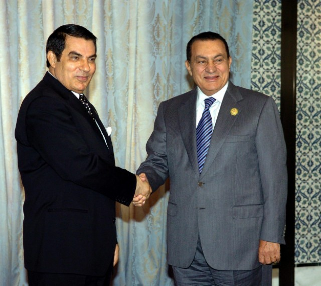 "EDITOR'S NOTE - RESTRICTED TO EDITORIAL USE - MANDATORY CREDIT ""AFP PHOTO / AL-MASRIYA TV"" - NO MARKETING NO ADVERTISING CAMPAIGNS - DISTRIBUTED AS A SERVICE TO CLIENTS An image grab taken from Egyptian state televsion Al-Masriya on February 10, 2011 from an undated footage shows Egyptian President Hosni Mubarak (L) meeting with Vice President Omar Suleiman in Cairo. AFP PHOTO / AL-MASRIYA TV , (FILES) -- File picture dated June 23, 2010 shows Egyptian president Hosni Mubarak during an official meeting at the presidential palace in Cairo. Mubarak said in a televised speech on February 10, 2011 that he would hand over power to his deputy and former intelligence chief Omar Suleiman. AFP PHOTO/KHALED DESOUKI , (FILES) -- In this combo of file pictures, Egyptian President Hosni Mubarak (R) is seen during an official meeting at the presidential palace in Cairo on February 9, 2011 and his deputy Omar Suleiman is pictured on September 20, 2007 during a press briefing in the Egyptian capital. The embattled Egyptian leader delegated on February 10, 2011 power to Suleiman, the former intelligence chief, and proposed constitutional reforms. AFP PHOTO / CRIS BOURONCLE / KHALED DESOUKI , (FILES) -- File picture dated February 20, 2003 shows Egyptian President Hosni Mubarak and his wife, Suzanne upon their arrival at the Palais de l'Elys?e in Paris before an official diner. The embattled Egyptian president left Cairo with his family on February 11, 2011, a source close to the government told AFP, but his destination was not immediately clear.         AFP PHOTO/JACK GUEZ , Egyptian anti-goverment demonstrators shout slogans against President Hosni Mubarak at Cairo's Tahrir Square on February 10, 2011, on the 17th day of protests against President Hosni Mubarak's regime. Thousands more Egyptian demonstrators joined a mounting tide of protest against Mubarak's regime despite stark threats of a government crackdown. AFP PHOTO/PEDRO UGARTE , Egyptian anti-goverment demonstrators pray and read newspapers in front of military vehicles in Cairo's landmark Tahrir Square in the early hours of February 11, 2011, as the 18th day of protests against President Hosni Mubarak's regime beings with furious Egyptian protesters vowing to step up their revolt after Mubarak refused to quit office. Arabic graffiti on armoured vehicle (R) reads: ""Down with Mubarak.. No to Mubarak and no to Suleiman"", in reference to Vice President Amr Suleiman.  AFP PHOTO/PEDRO UGARTE , An Egyptian anti-goverment protester reads a newspaper as he rests against an army tank positioned in Cairo's landmark Tahrir Square in the early hours of February 11, 2011, as the 18th day of protests against President Hosni Mubarak's regime beings with furious Egyptian protesters vowing to step up their revolt after Mubarak refused to quit office.   AFP PHOTO/PEDRO UGARTE , Egyptian anti-goverment demonstrators flood Cairo's landmark Tahrir Square early on February 11, 2011, the 18th day of protests against President Hosni Mubarak who refused to quit office in a much-awaited speech the previous night.   AFP PHOTO/PEDRO UGARTE , Egyptian anti-goverment protestors carry a man who fainted while performing the Friday noon prayer during protests in Cairo's landmark Tahrir Square on February 11, 2011. Tens of thousands of demonstrators reacted with fury after the military threw its weight behind President Mubarak's attempt to cling on to power despite massive nationwide protests over the past 18 days.   AFP PHOTO/PEDRO UGARTE , Egyptian anti-goverment demonstrators shout slogans against President Hosni Mubarak's regime during protests in Cairo's landmark Tahrir Square on February 11, 2011, as anti-Mubarak protesters reacted with fury after the military threw its weight behind his attempt to cling on to power despite massive nationwide protests over the past 18 days.   AFP PHOTO/PEDRO UGARTE , Egyptian anti-government protestors demonstrate raising their shoes in front of the Egyptian national TV building, which is currently secured by the Egyptian Army, in central Cairo on February 11, 2011. Egyptian demonstrators reacted with fury after the military threw its weight behind President Mubarak's attempt to cling on to power despite massive nationwide protests. AFP PHOTO/MARCO LONGARI , Egyptian anti-goverment demonstrators carry on with their protest in Cairo's landmark Tahrir Square on February 11, 2011, after the military threw its weight behind President Mubarak's attempt to cling on to power despite massive nationwide protests over the past 18 days.   AFP PHOTO/PATRICK BAZ , Egyptian soldiers guard the national TV building in Cairo as anti-government demonstrators wave national flags during continuing protests on February 11, 2011 after the military threw its weight behind President Mubarak's attempt to cling on to power despite massive nationwide protests. AFP PHOTO/MARCO LONGARI , Egyptian anti-government protesters gather in Cairo's landmark Tahrir Square on February 11, 2011, after the military threw its weight behind President Mubarak's attempt to cling on to power despite massive nationwide protests over the past 18 days.   AFP PHOTO/PATRICK BAZ , An Egyptian girl waves a national flag beneath a banner of the opposition Kefaya party which bears a picture of a cracked bust of Egypt's embattled President Hosni Mubarak with Arabic writing below reading ""invalid"" during protests in Cairo on February 11, 2011. The Egyptian military threw its weight behind Mubarak's attempt to cling on to power despite massive nationwide protests over the past 18 days.   AFP PHOTO/PATRICK BAZ , Egyptian army troops adjust barbed wire outside Cairo's presidential palace in Heliopolis as anti-government demonstrators approach the building on February 11, 2011, following news that President Hosni Mubarak left the capital with his family, according to a source close to the government. AFP PHOTO/MOHAMMED ABED , Egyptian anti-government protesters gather outside the state television building in Cairo on February 11, 2011. Thousands of demonstrators massed at Egypt's state television building and at President Hosni Mubarak's palace in the Cairo suburbs as anti-regime protests spread across the city. AFP PHOTO/KHALED DESOUKI , Egyptian anti-government protesters shout slogans outside the state television building in Cairo on February 11, 2011. Thousands of demonstrators massed at Egypt's state television building and at President Hosni Mubarak's palace in the Cairo suburbs as anti-regime protests spread across the city. AFP PHOTO/KHALED DESOUKI , Egyptian anti-government protesters wave their shoes outside the state television building in Cairo on February 11, 2011. Thousands of demonstrators massed at Egypt's state television building and at President Hosni Mubarak's palace in the Cairo suburbs as anti-regime protests spread across the city. AFP PHOTO/KHALED DESOUKI , Egyptian anti-government protesters sit near an army tank as they gather outside the state television building in Cairo on February 11, 2011. Thousands of demonstrators massed at Egypt's state television building and at President Hosni Mubarak's palace in the Cairo suburbs as anti-regime protests spread across the city. AFP PHOTO/KHALED DESOUKI , An Egyptian anti-government protester uses a magnifier to read a newspaper in Cairo's Tahrir Square on February 11, 2011. Thousands of demonstrators massed at Egypt's state television building and at President Hosni Mubarak's palace in the Cairo suburbs as anti-regime protests spread across the city. AFP PHOTO/KHALED DESOUKI , Egyptian anti-government protesters try to make their way through barbed wires as they gather outside the state television building in Cairo on February 11, 2011. Thousands of demonstrators massed at Egypt's state television building and at President Hosni Mubarak's palace in the Cairo suburbs as anti-regime protests spread across the city. AFP PHOTO/KHALED DESOUKI , Egyptian anti-government protesters shout slogans outside the state television building in Cairo on February 11, 2011. Thousands of demonstrators massed at Egypt's state television building and at President Hosni Mubarak's palace in the Cairo suburbs as anti-regime protests spread across the city. AFP PHOTO/KHALED DESOUKI , An Egyptian anti-goverment demonstrator shouts slogans against President Hosni Mubarak as protesters gather outside the presidential palace in Cairo on February 11, 2011. Mubarak flew out of Cairo to his Red Sea retreat as more than a million furious Egyptians marched in cities around the country to demand he step down. AFP PHOTO/MOHAMMED ABED , Egyptian anti-government protesters shout slogans against President Hosni Mubarak outside the presidential palace in Cairo on February 11, 2011. Mubarak flew out of Cairo to his Red Sea retreat as more than a million furious Egyptians marched in cities around the country to demand he step down. AFP PHOTO/MOHAMMED ABED , Egyptian anti-government demonstrators walk from the Ramses train station in downtown Cairo towards the presidential palace in the suburb of Heliopolis on February 11, 2011, as people reacted with fury after the military threw its weight behind President Mubarak's attempt to cling on to power despite massive nationwide protests over the past 18 days. AFP PHOTO/AMR AHMAD , Egyptian anti-government protesters stand opposite soldiers guarding the presidential palace in Cairo on February 11, 2011. President Hosni Mubarak flew out of Cairo to his Red Sea retreat as more than a million furious Egyptians marched in cities around the country to demand he step down. AFP PHOTO/MOHAMMED ABED , Egyptian anti-government protesters stand opposite soldiers guarding the presidential palace in Cairo on February 11, 2011. President Hosni Mubarak flew out of Cairo to his Red Sea retreat as more than a million furious Egyptians marched in cities around the country to demand he step down. AFP PHOTO/MOHAMMED ABED , Egyptian anti-government protesters gather outside the presidential palace in Cairo on February 11, 2011. President Hosni Mubarak flew out of Cairo to his Red Sea retreat as more than a million furious Egyptians marched in cities around the country to demand he step down. AFP PHOTO/MOHAMMED ABED , Egyptian anti-government protesters carry a huge banner with names and pictures of victims killed during protests at Cairo's Tahrir Square on February 11, 2011. President Hosni Mubarak flew out of Cairo to his Red Sea retreat as more than a million furious Egyptians marched in cities around the country to demand he step down. AFP PHOTO/KHALED DESOUKI , Anti-goverment demonstrators shout slogans against Egyptian President Hosni Mubarak outside the presidential palace in Cairo on February 11, 2011. Mubarak flew out of Cairo to his Red Sea retreat as more than a million furious Egyptians marched in cities around the country to demand he step down. AFP PHOTO/MOHAMMED ABED , A young Jordanian demonstrator holds the Koran, Islam's holy book, while shouting slogans during a protest against Egyptian President Hosni Mubarak outside the Egyptian embassy in Amman on February 11, 2011. Mubarak flew out of Cairo to his Red Sea retreat as more than a million furious Egyptians marched in cities around the country to demand he step down. AFP PHOTO/KHALIL MAZRAAWI , A Jordanian demonstrator shouts slogans as people gather for a protest against Egyptian President Hosni Mubarak outside the Egyptian embassy in Amman on February 11, 2011. Mubarak flew out of Cairo to his Red Sea retreat as more than a million furious Egyptians marched in cities around the country to demand he step down. AFP PHOTO/KHALIL MAZRAAWI , EDITOR'S NOTE - RESTRICTED TO EDITORIAL USE - MANDATORY CREDIT ""AFP PHOTO / AL-MASRIYA TV"" - NO MARKETING NO ADVERTISING CAMPAIGNS - DISTRIBUTED AS A SERVICE TO CLIENTS An image grab taken from Egyptian state television Al-Masriya shows new Egyptian Vice President Omar Suleiman delivering an address in Cairo on February 11, 2011. Egyptian President Hosni Mubarak has stepped down, Suleiman said. AFP PHOTO / AL-MASRIYA TV , (FILES) -- A File picture released on June 12, 1981 shows Egyptian Vice President at the time Hosni Mubarak in Paris. Mubarak, 82, stepped down on February 11, 2011 after 30 years in power following the assassination of late president Anwar Sadat and handed power to the Supreme Council of the Armed Forces, Vice President Omar Suleiman said in a brief televised statement. AFP PHOTO , (FILES) A picture taken on May 22, 2004 shows Egyptian President Hosni Mubarak (R) shaking hands with now ousted Tunisian President Zine El Abidine ben Ali in Tunis. Cairo erupted with joyful dancing, singing and cries of ""God is greatest!"" on February 11, 2011 as Mubarak's 30-year rule came to an end following more than two weeks of mass protests. AFP PHOTO/AYMAN TRAWI"