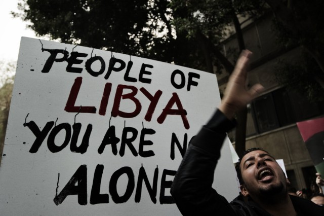 A protester shouts slogans against Libyan leader Moamer Kadhafi during a demonstration outside the Libyan embassy in the Egyptian capital Cairo on February 20, 2011 in support of anti-government protesters in Libya calling for Kadhafi's ouster. AFP PHOTO/GIANLUIGI GUERCIA