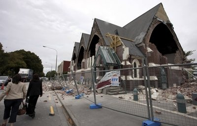 People walk past a church in Christchurch, New Zealand, which was destroyed after an earthquake struck Tuesday, Feb. 22, 2011. The 6.3-magnitude quake collapsed buildings and is sending rescuers scrambling to help trapped people amid reports of multiple deaths. (AP Photo/NZPA, Pam Johnson) NEW ZEALAND OUT, NO ARCHIVES, NO SALES