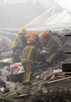 An injured women is dug out of rubble by rescue workers after an earthquake rocked Christchurch, New Zealand, Tuesday, Feb. 22, 2011. The 6.3-magnitude quake hit at the height of a busy workday Tuesday, toppling tall buildings and churches, crushing buses and killing dozens of people in one of the country's worst natural disasters. (AP Photo/NZPA, David Wethey) NEW ZEALAND OUT, NO ARCHIVES, NO SALES